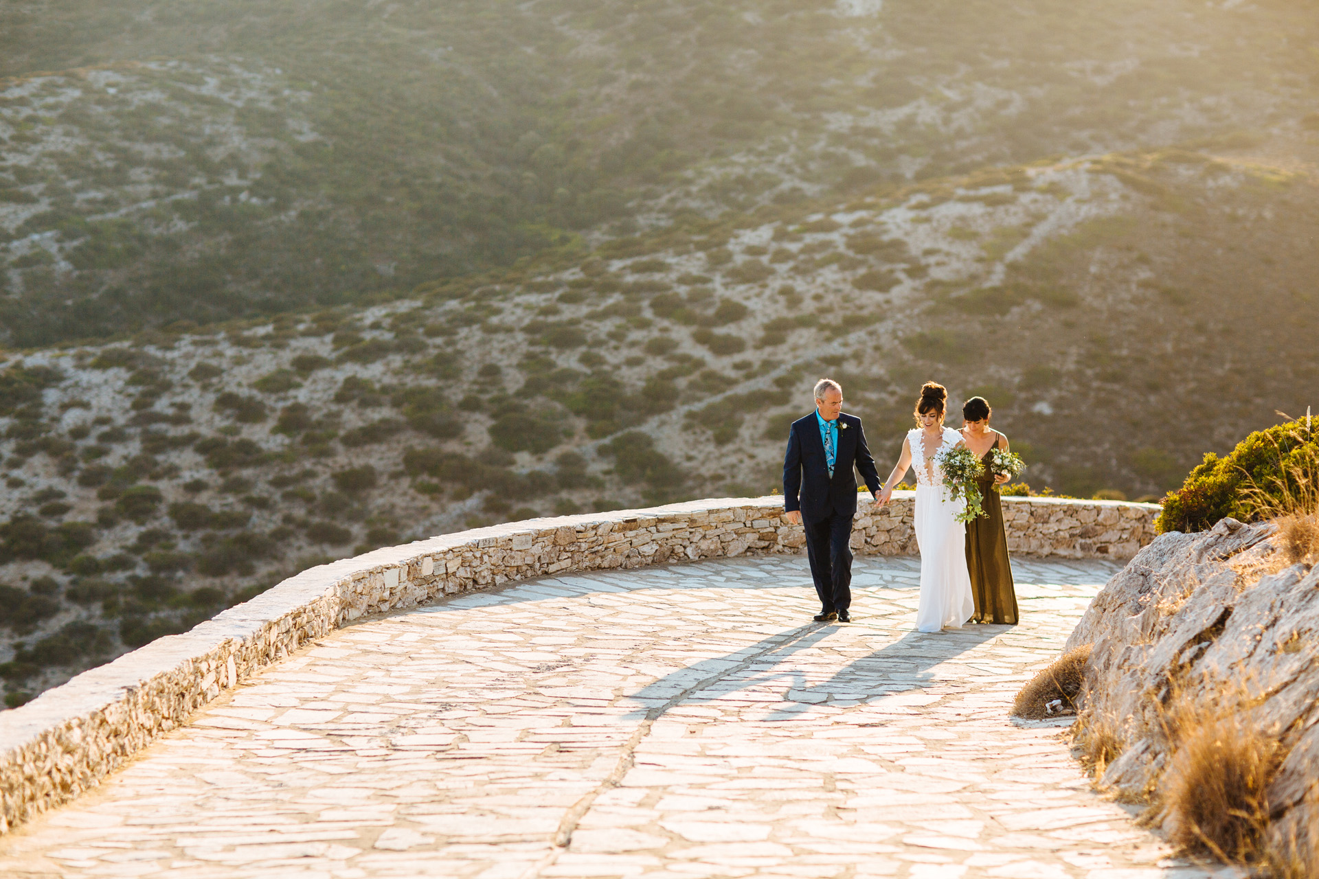 bride and father walking to wedding ceremony at Antiparos wedding