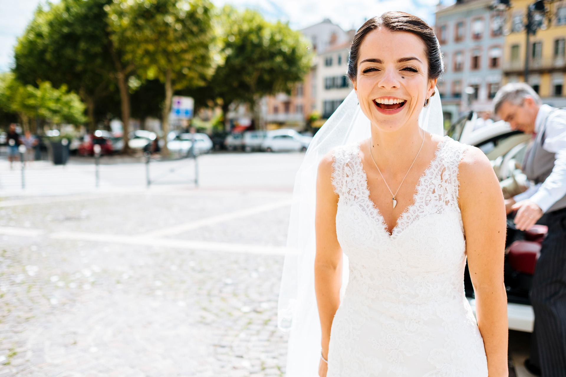 bride laughing outside church