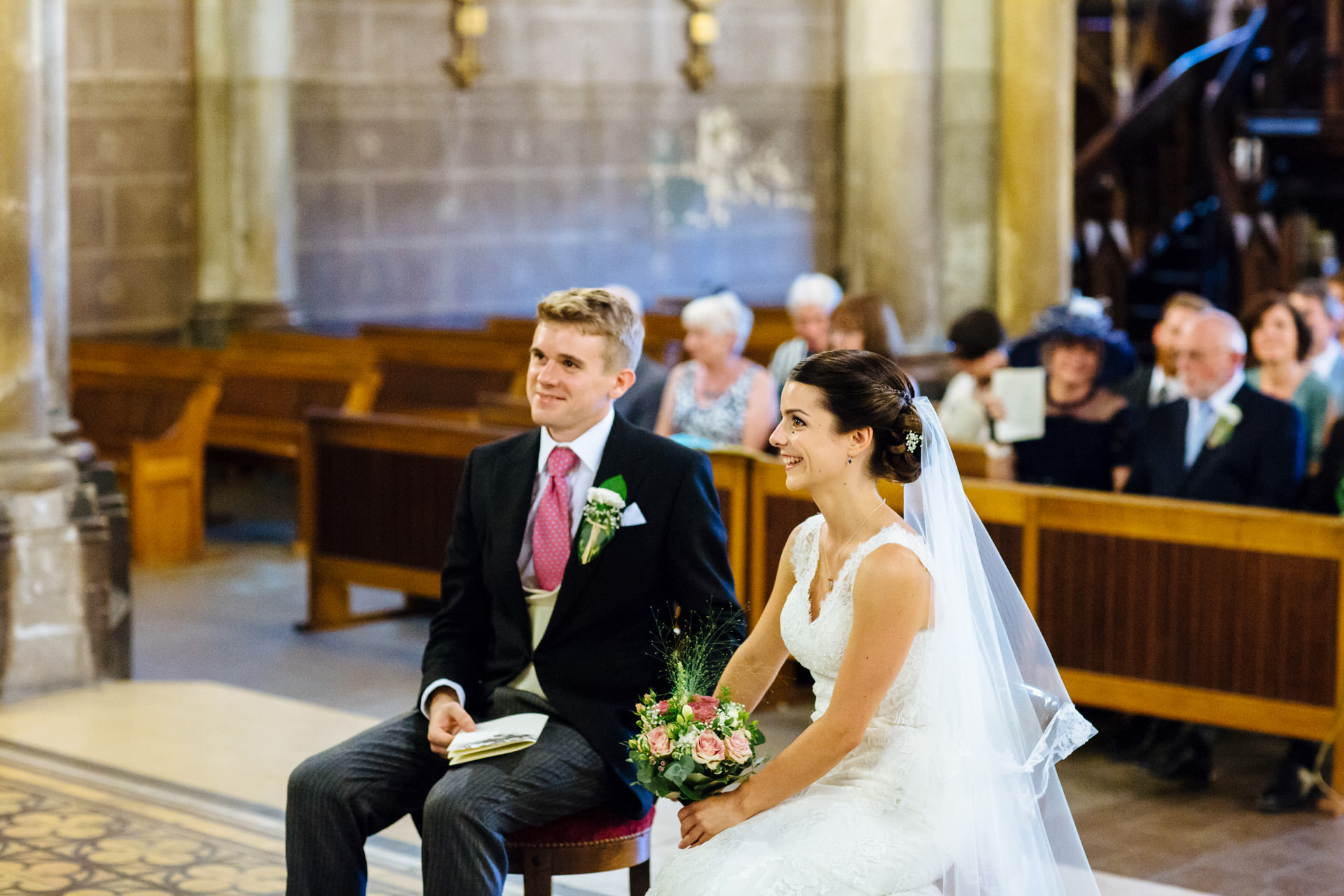 bride and groom listening to ceremony