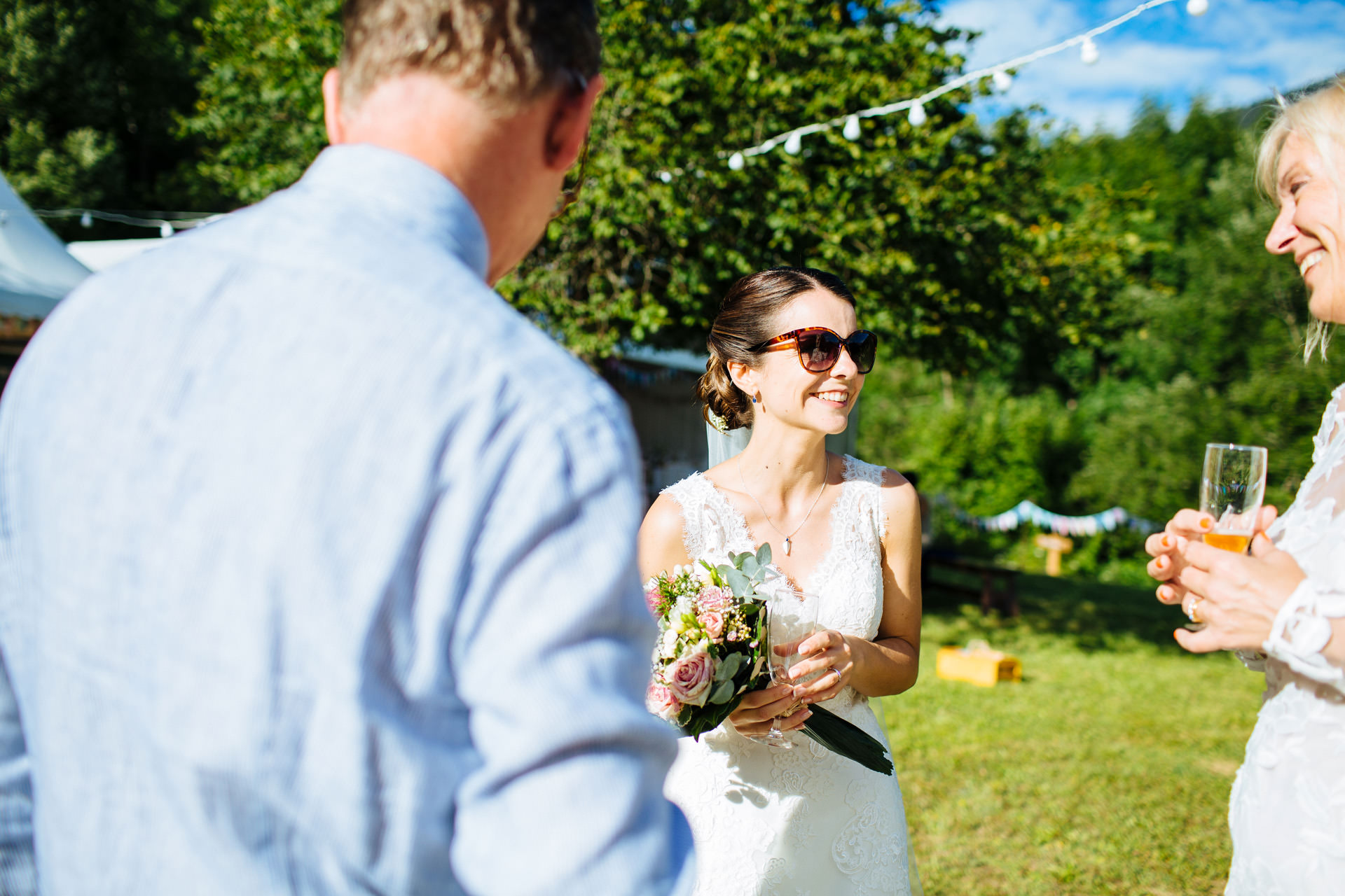 bride in sunglasses smiling