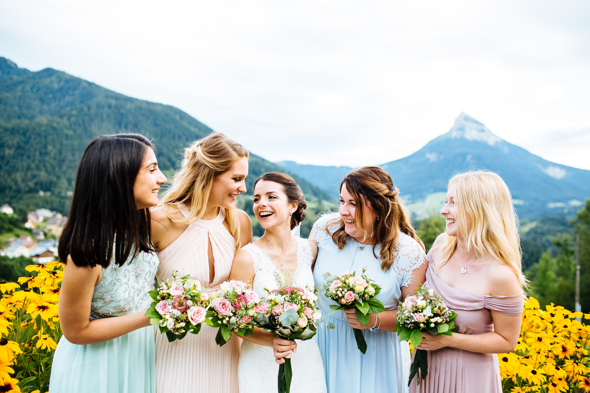 bride and bridesmaids in front of mountain