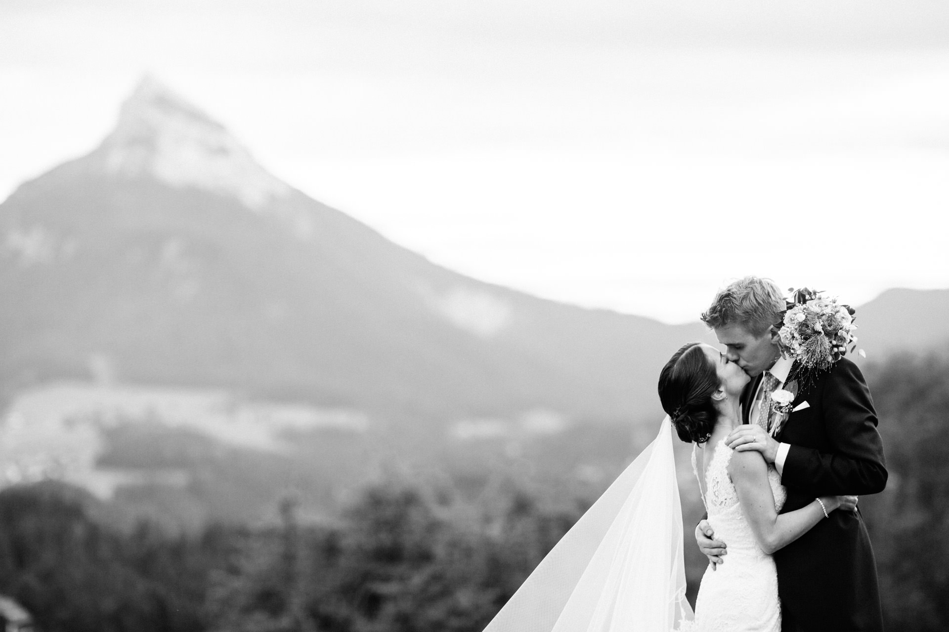 bride and groom in front of French alps