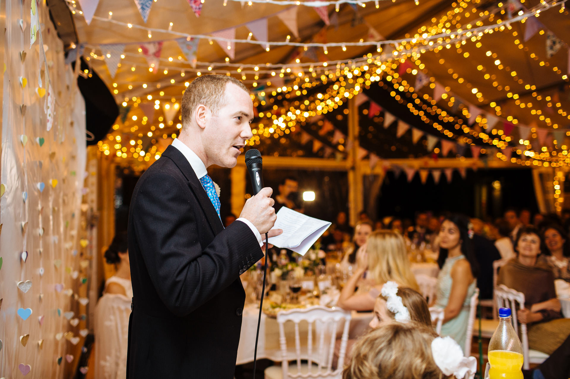 best man speech in marquee with fairy lights