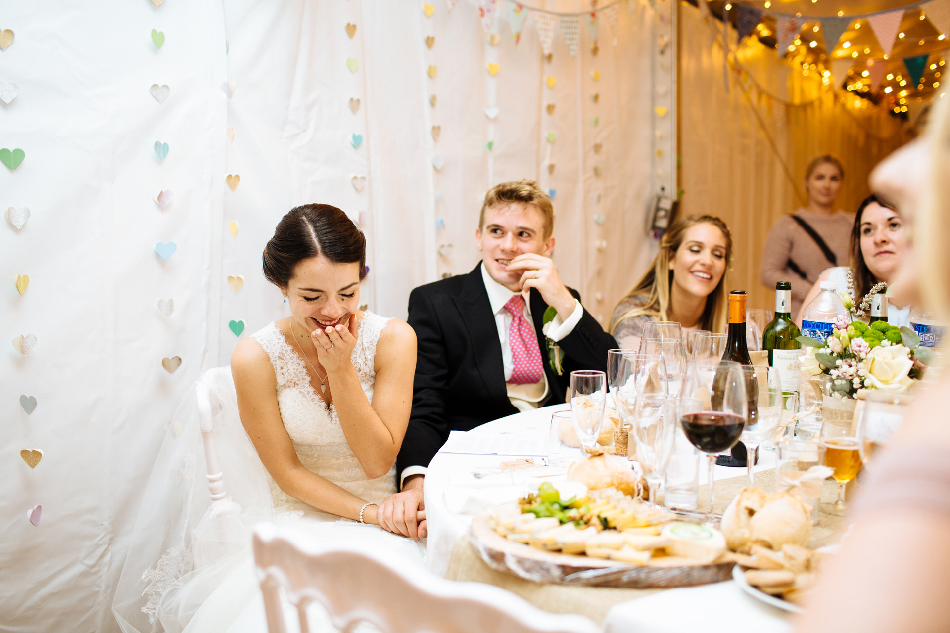 bride laughing and embarrassed during speech
