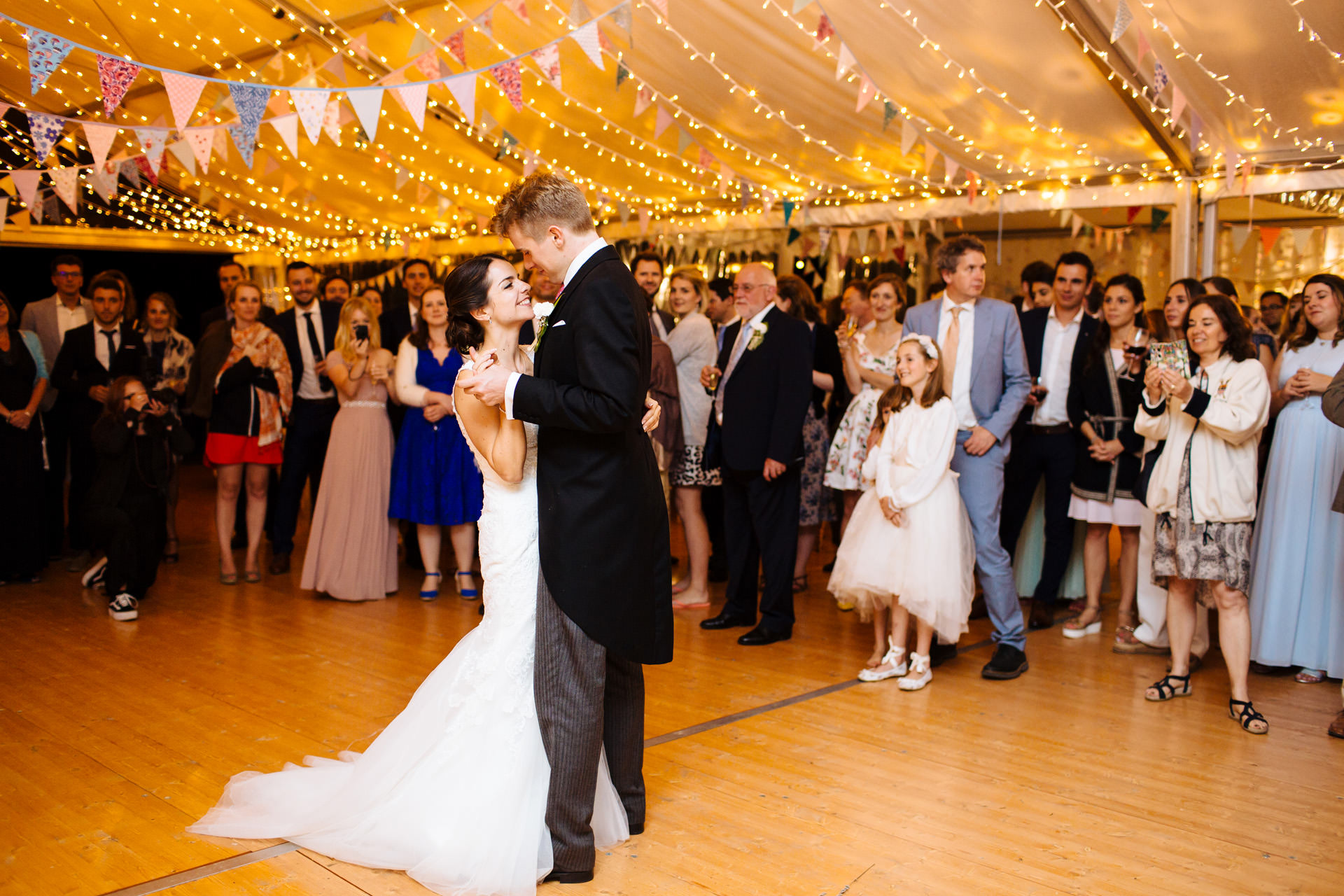 bride and groom first dance in cosy marquee