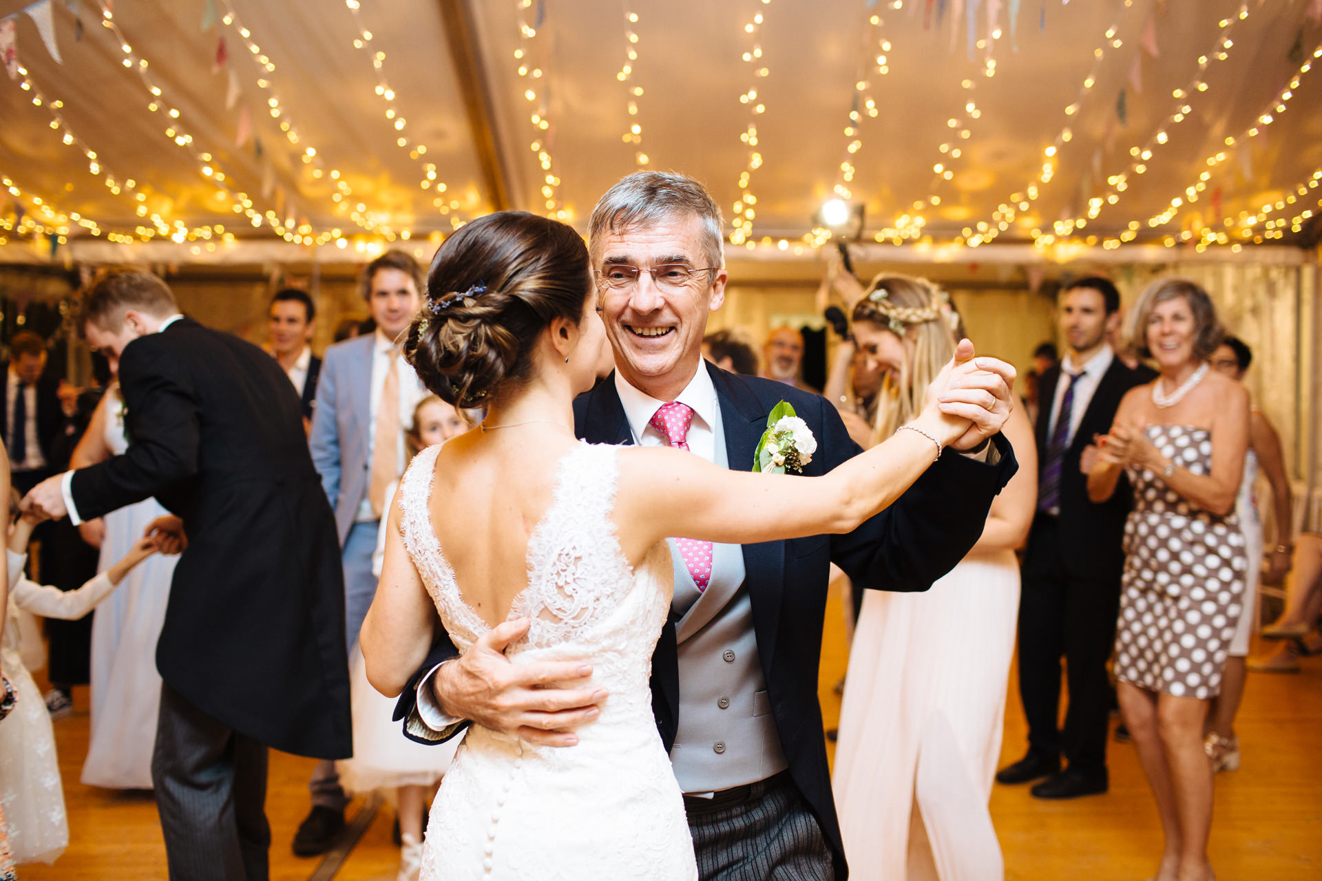 bride and father first dance in marquee