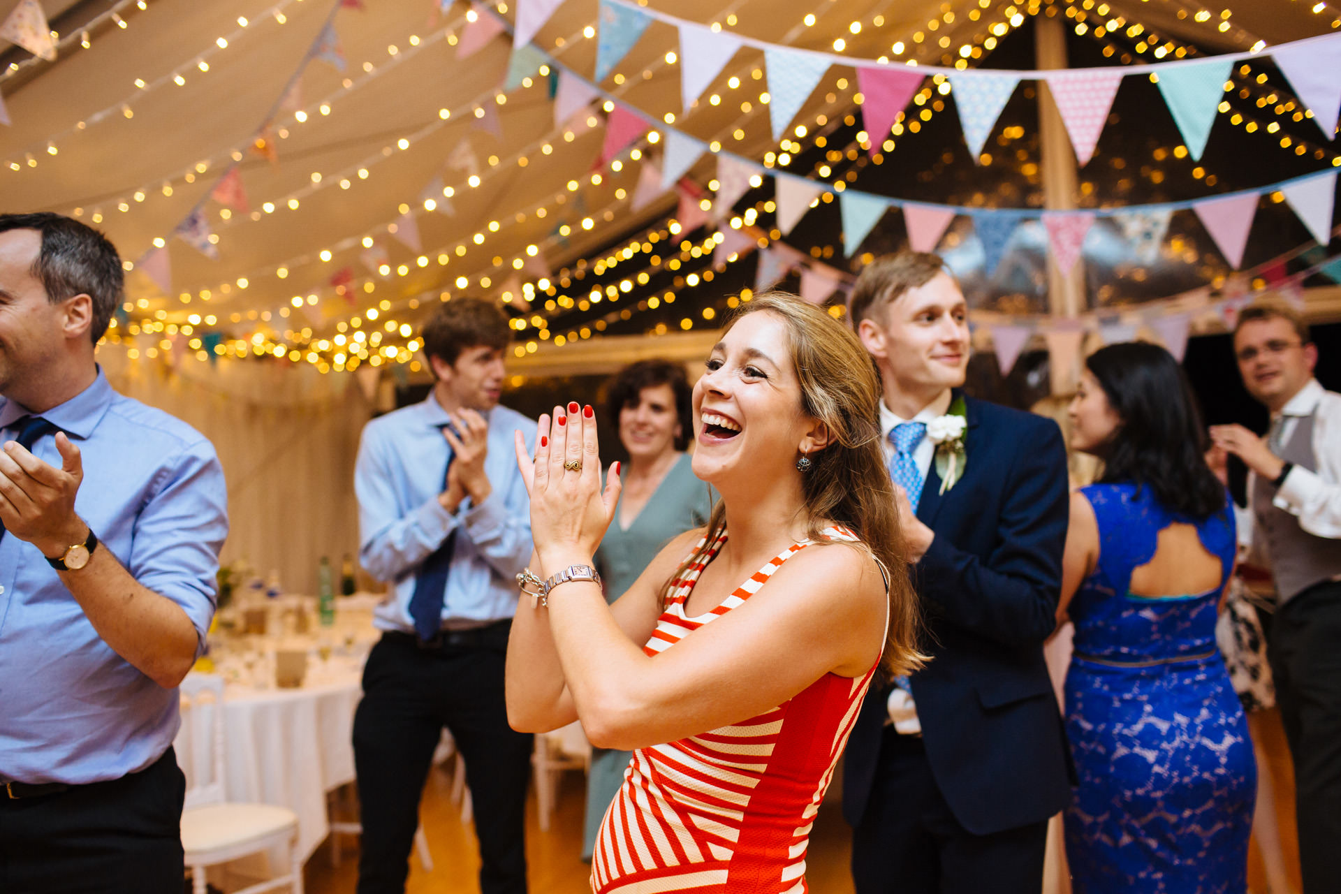 wedding guest clapping and dancing