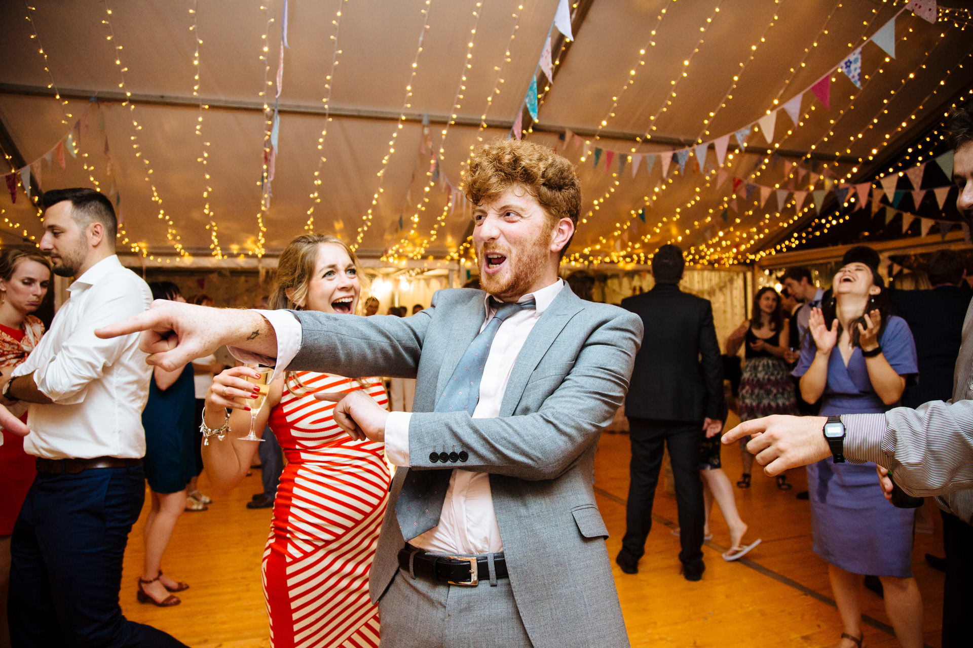 wedding guest laughing and dancing