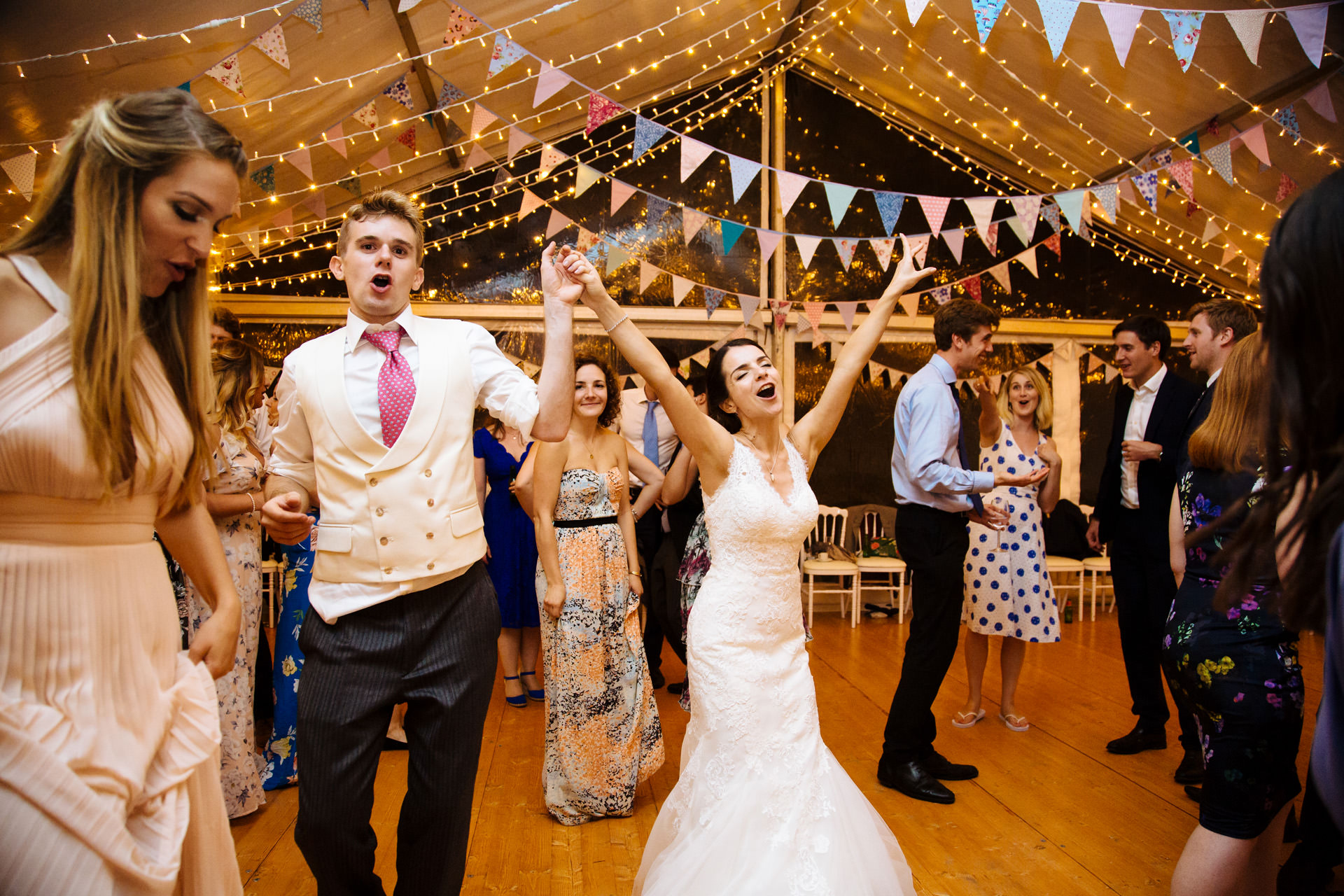 bride and groom singing and dancing in marquee