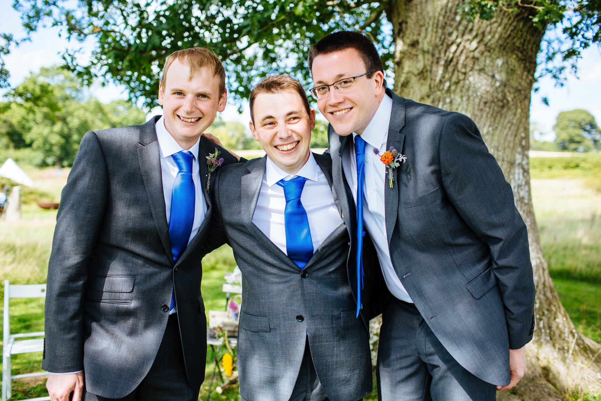 groom and groomsmen smiling