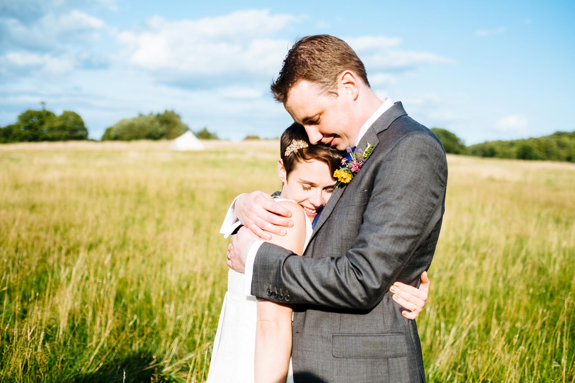 bride and groom tight hug