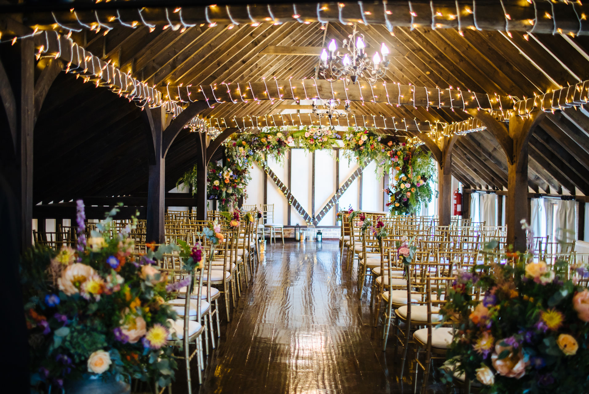 room decorated with rustic flower arch and fairy lights at blackstock country estate