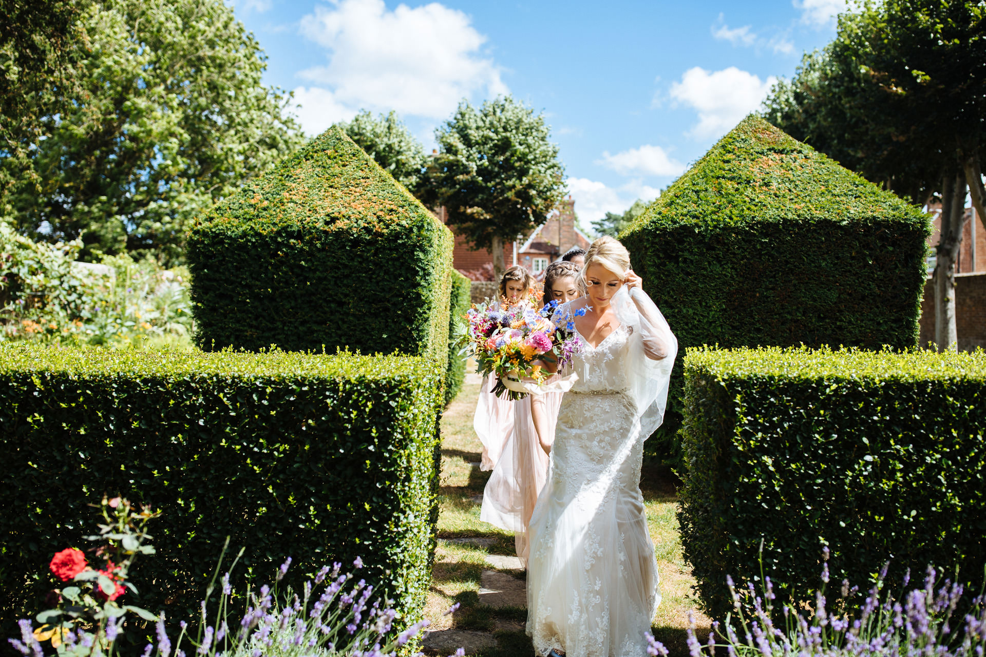 bride walking through garden to ceremony at blackstock country estate