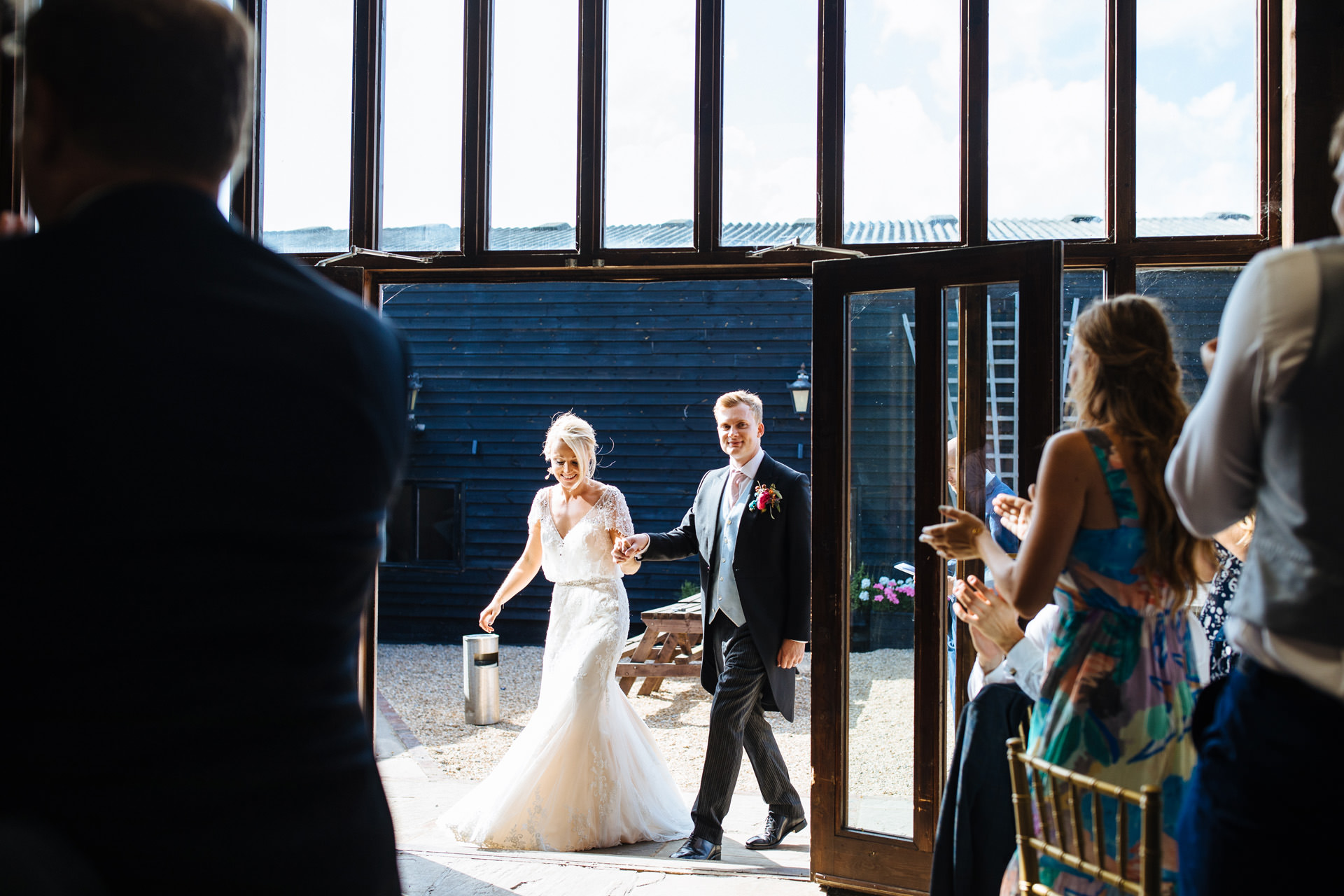 bride and groom entering the barn at black stock country estate