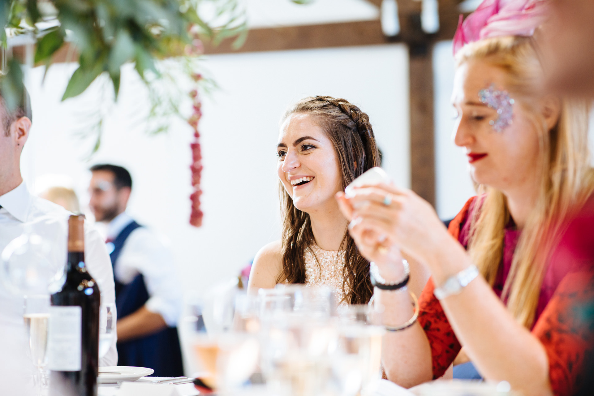 bridesmaid laughing at grooms wedding speech