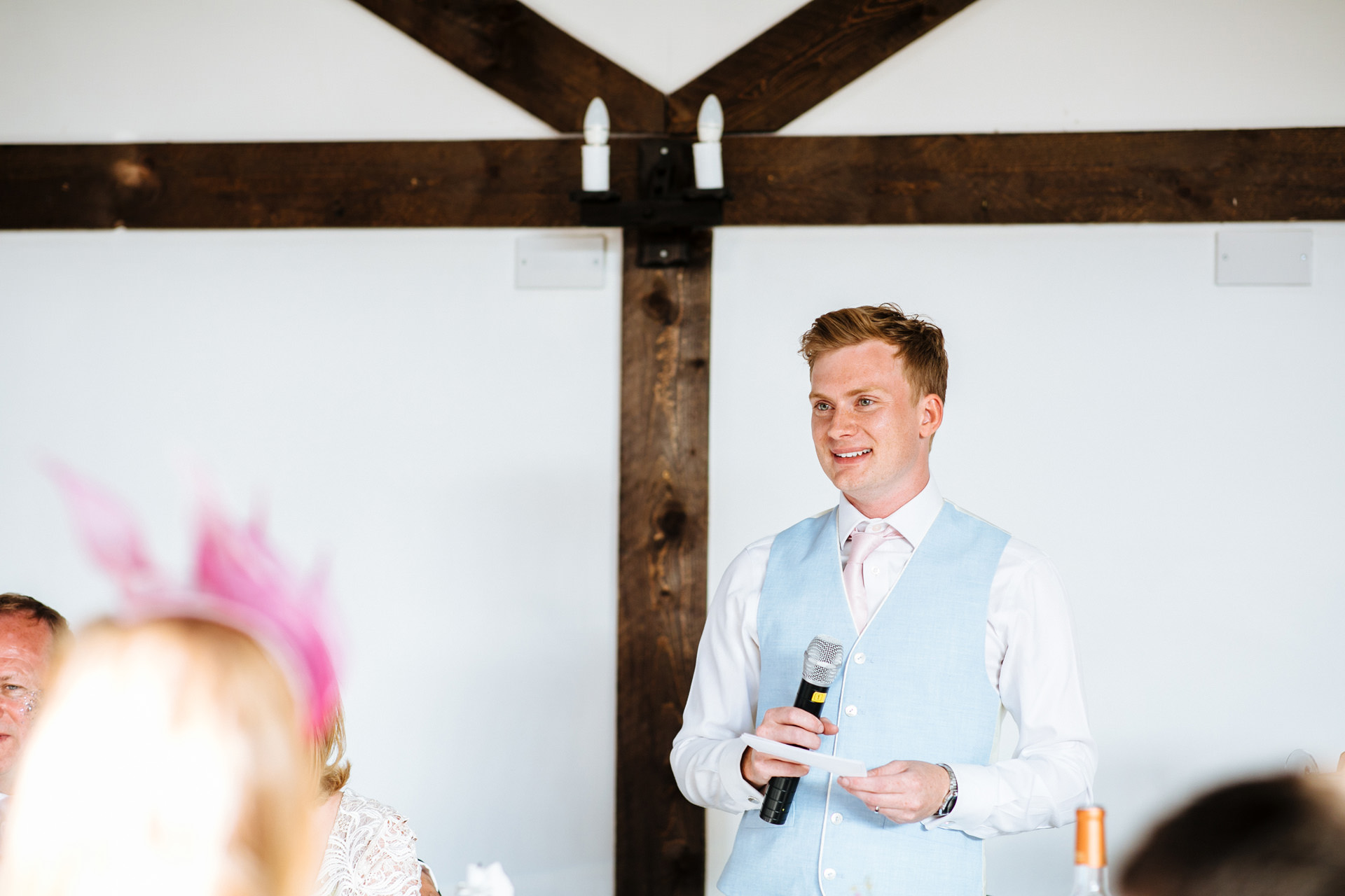 groom smiling and looking out to the room giving wedding speech at Blackstock country estate