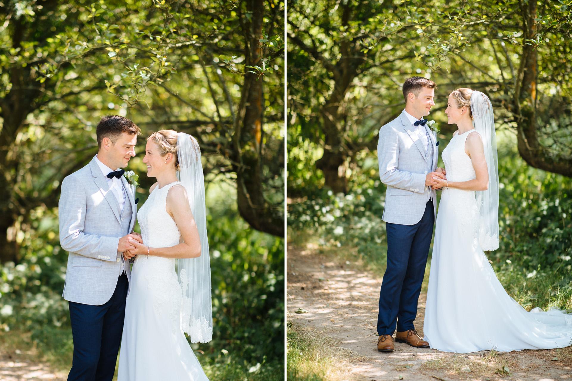 bride and groom cuddling in the woodland at kentfield farm wedding
