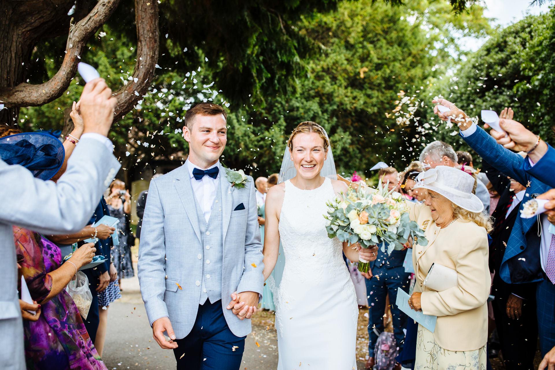 everyone throwing confetti on bride and groom at kentfield farm wedding