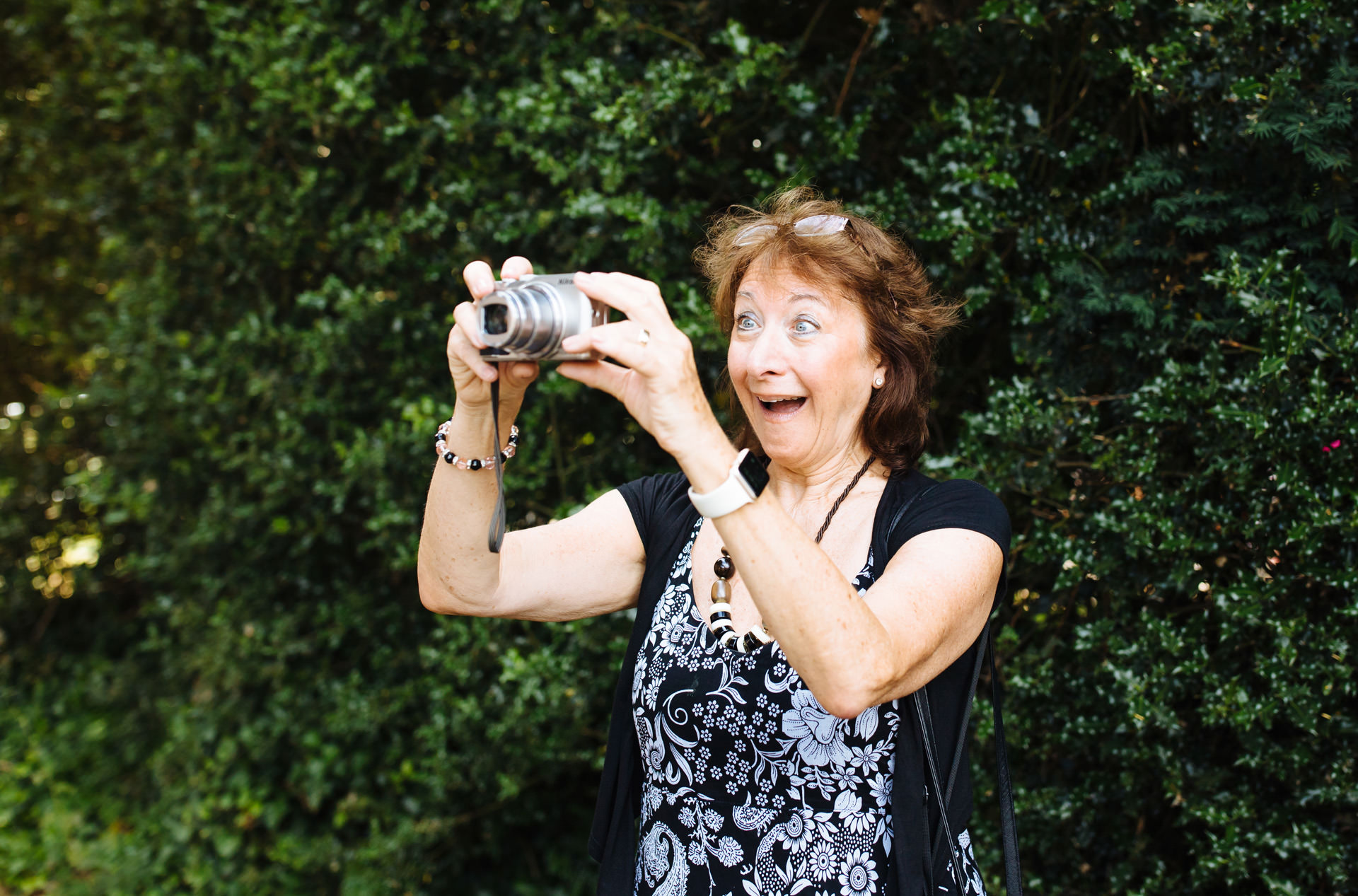 lady taking a picture and pulling a funny surprised face