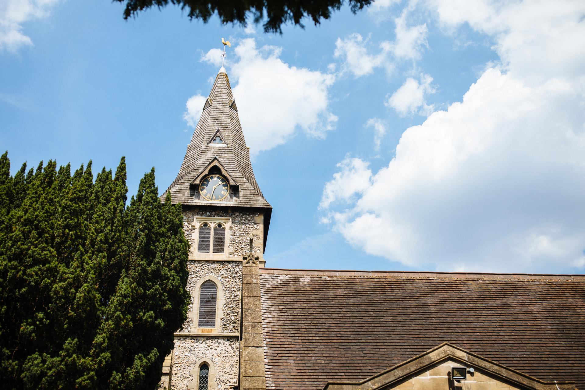 church spire in the sun against a blue sky