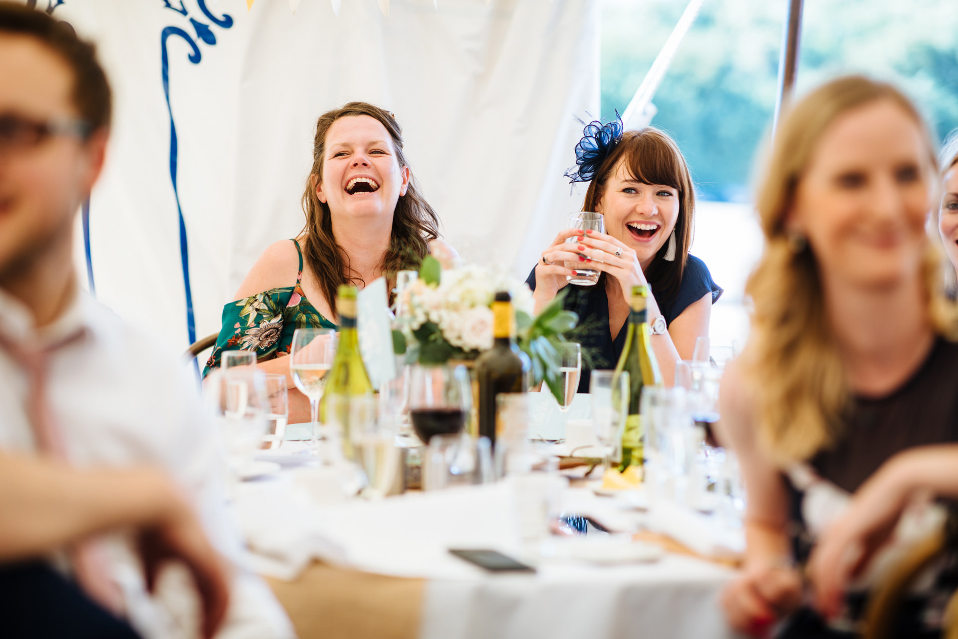 brides two friends laughing at speech