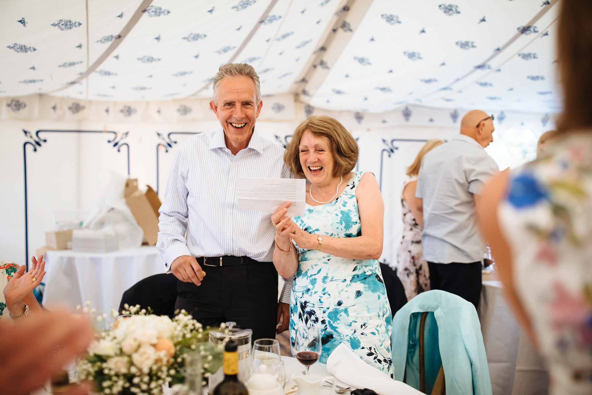 a husband and wife participating in singalong in the marquee