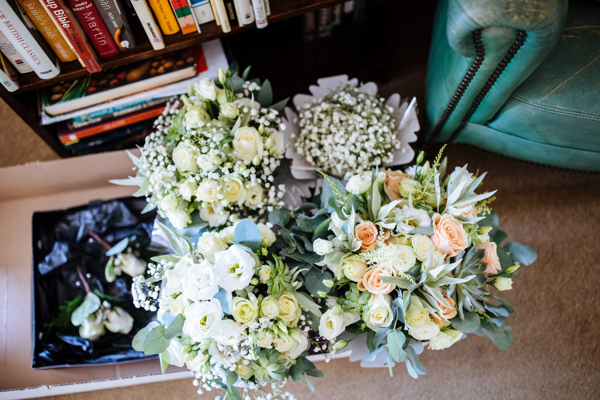 bride and bridesmaids bouquets of white and peach roses