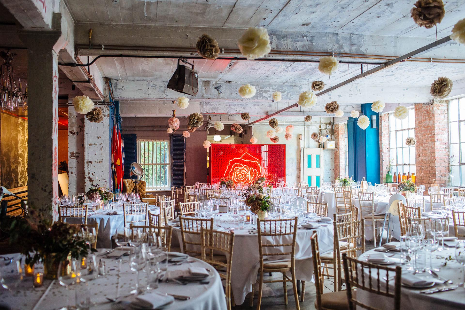 urban warehouse wedding with pom pom decorations