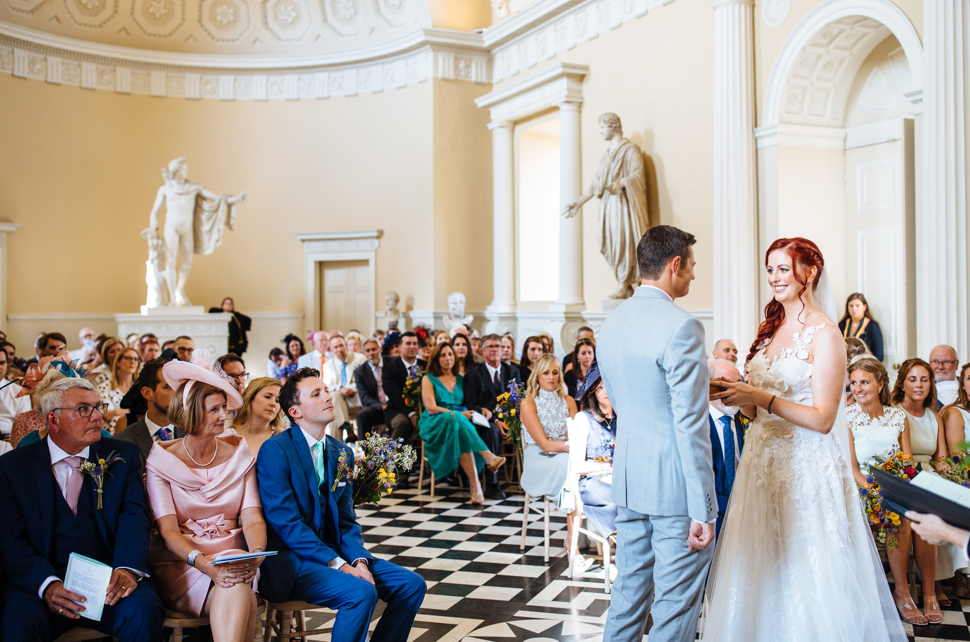 bride and groom saying vows in wedding ceremony in the great hall at syon park
