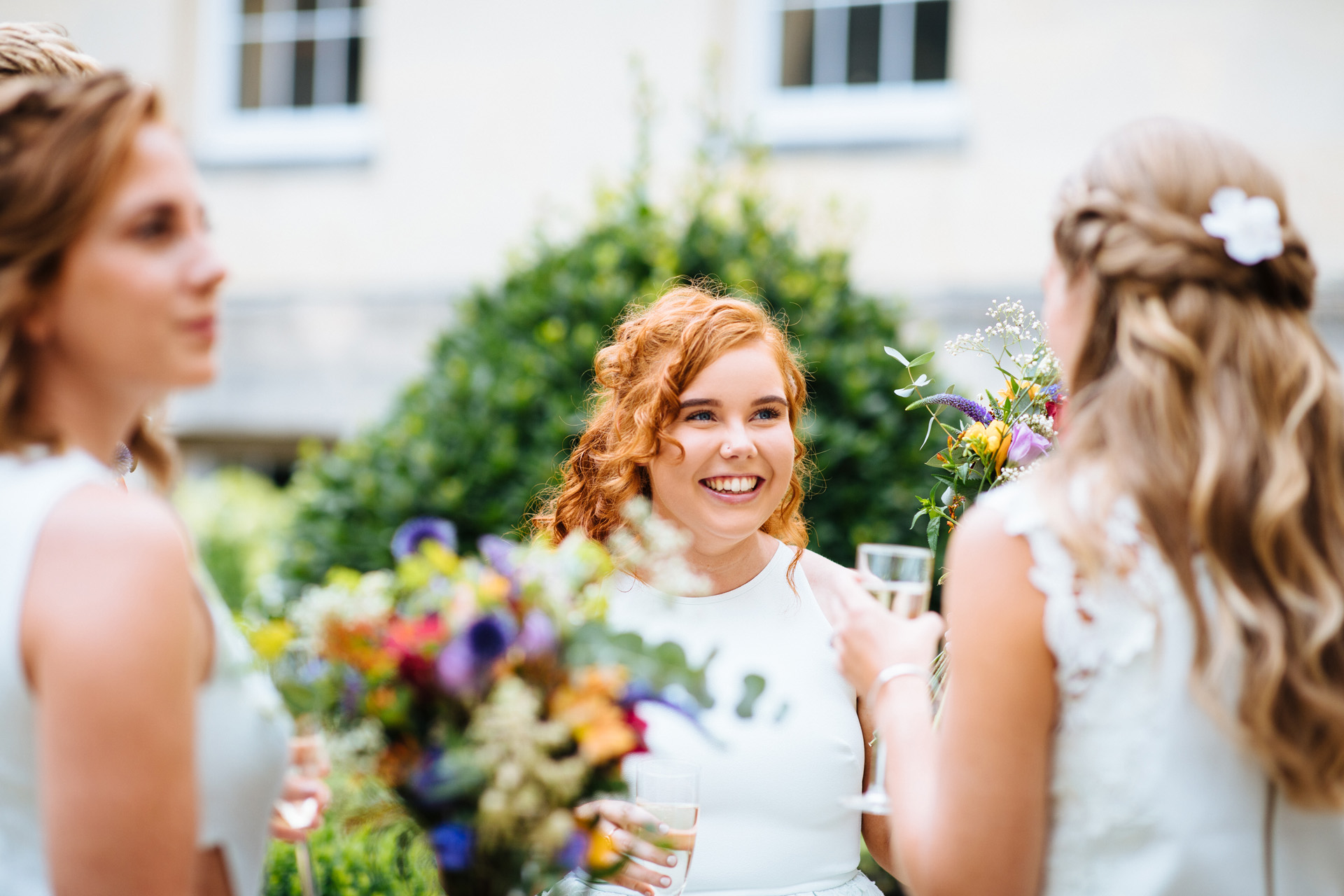 bridesmaid smiling with champagne