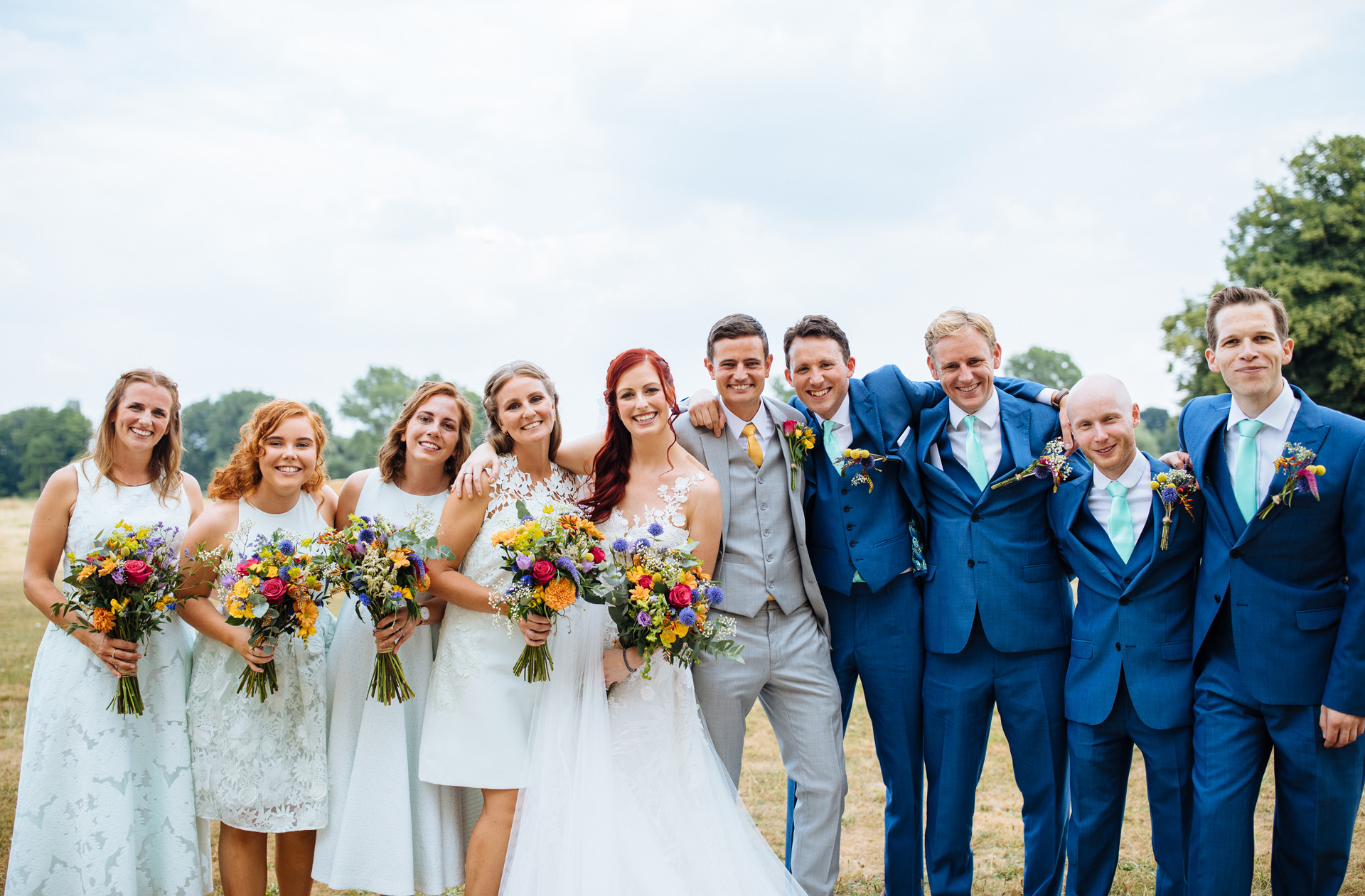bride and groom with bridal party at syon park wedding