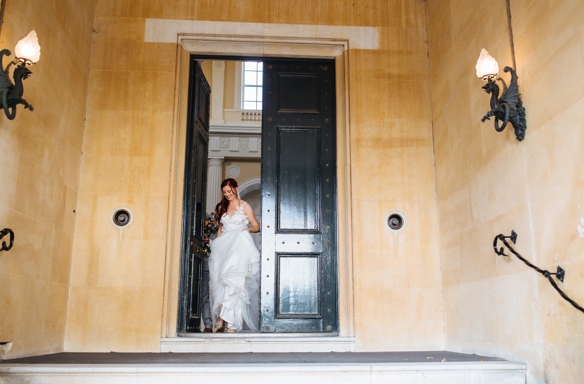 bride walking through door at syon park