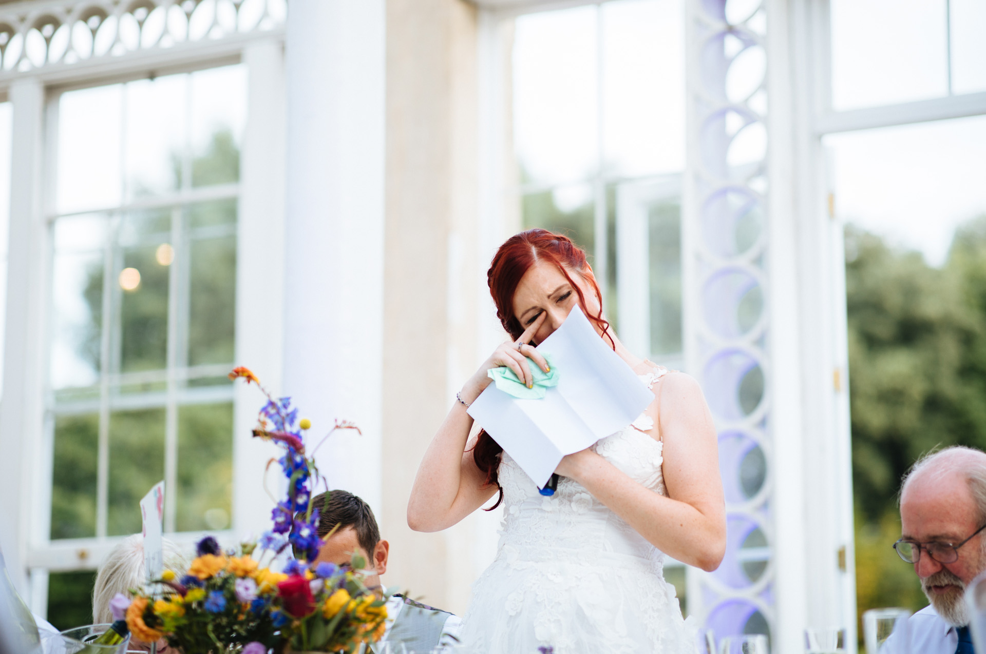 bride wiping away a tear during speech at syon park