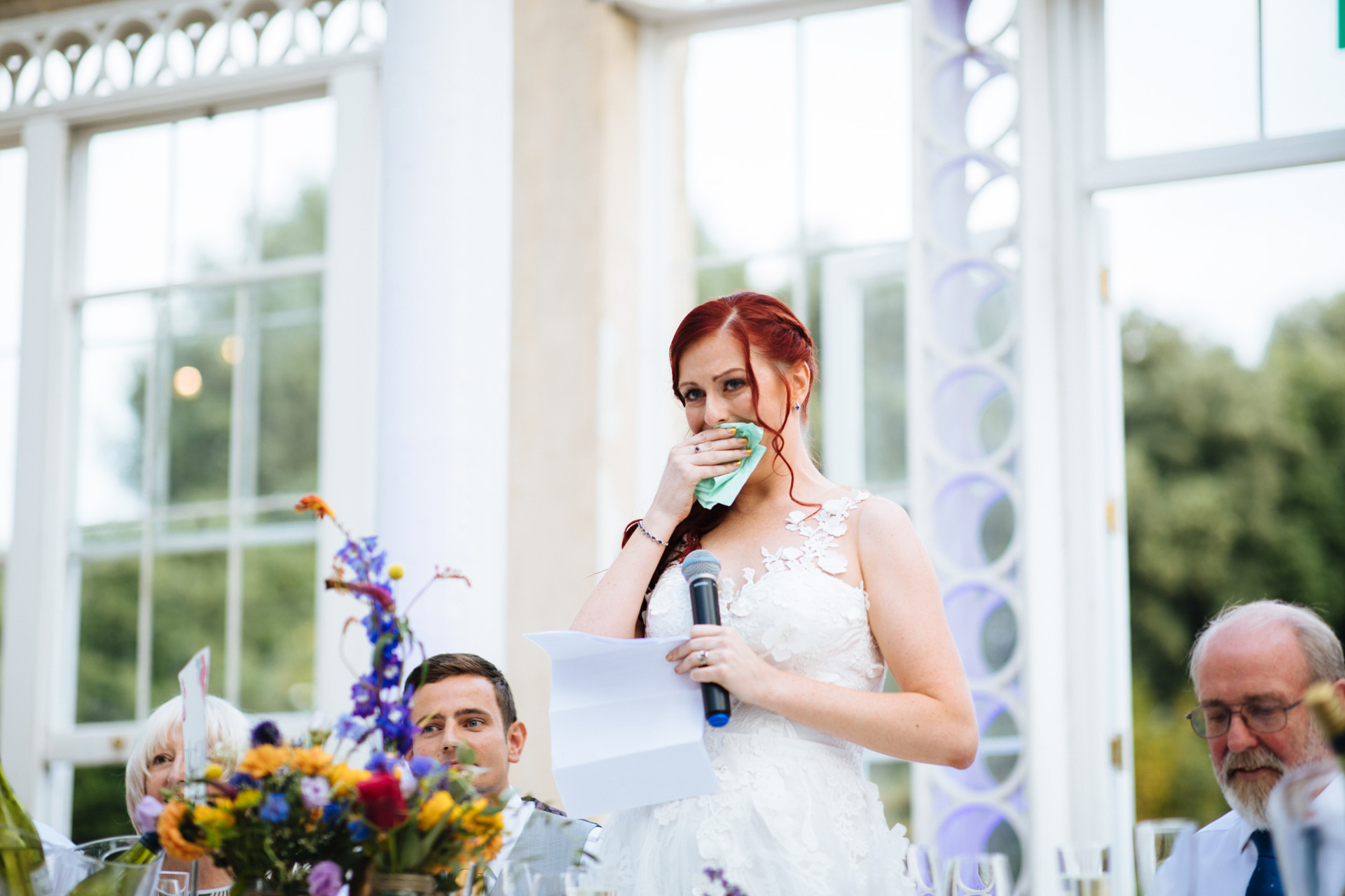 bride holding back tears during her wedding speech at syon park