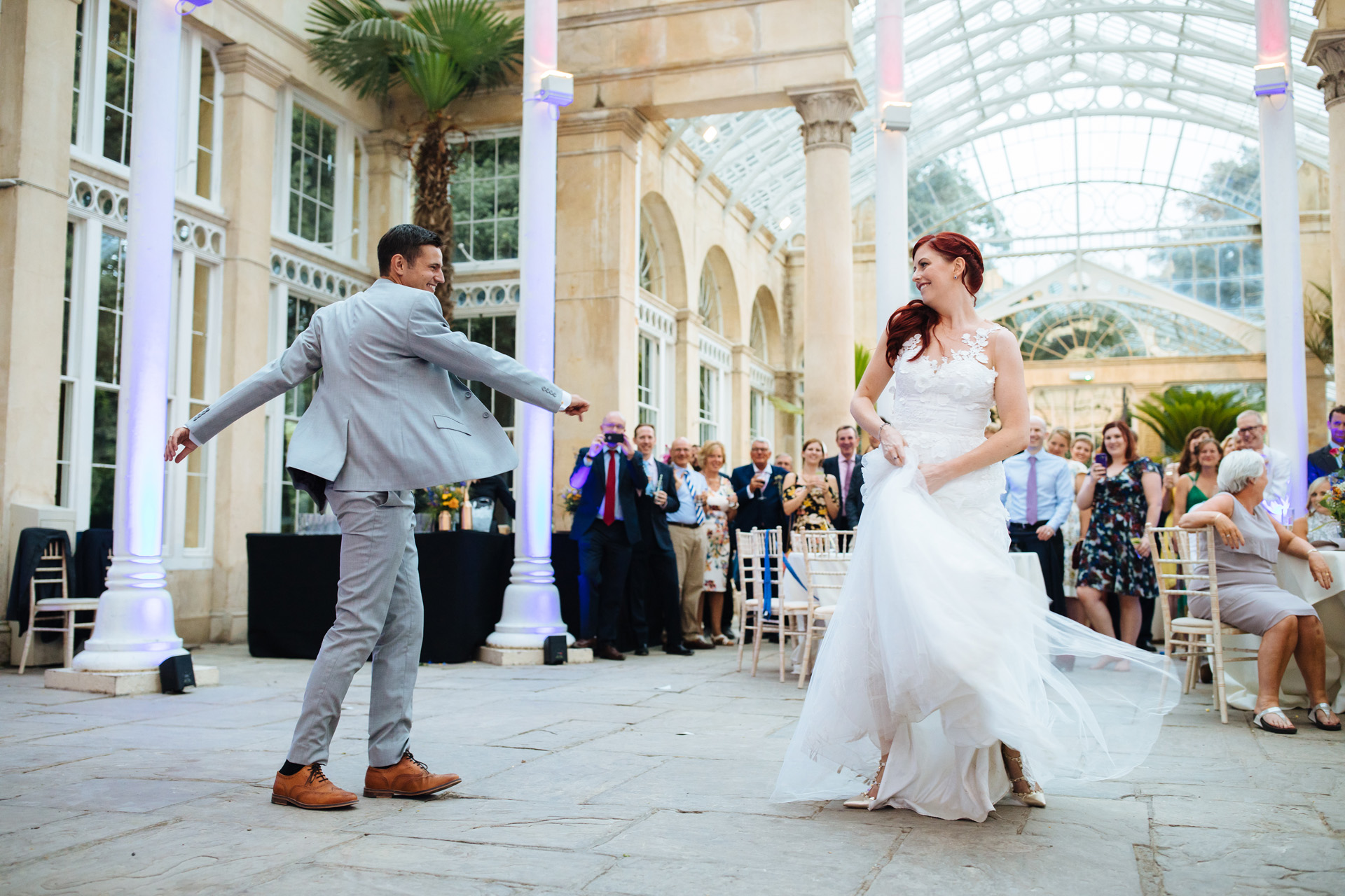 bride and groom twirling around in their first dance at syon park