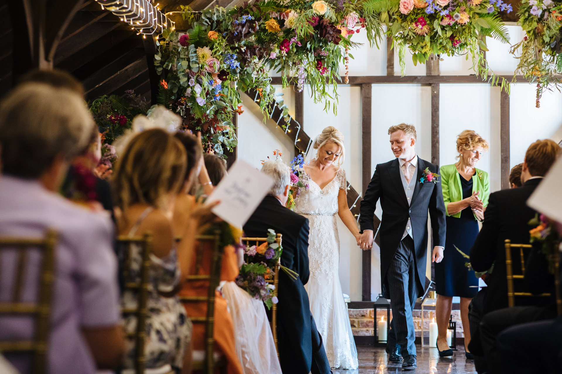 black stock country estate wedding ceremony underneath flower arch