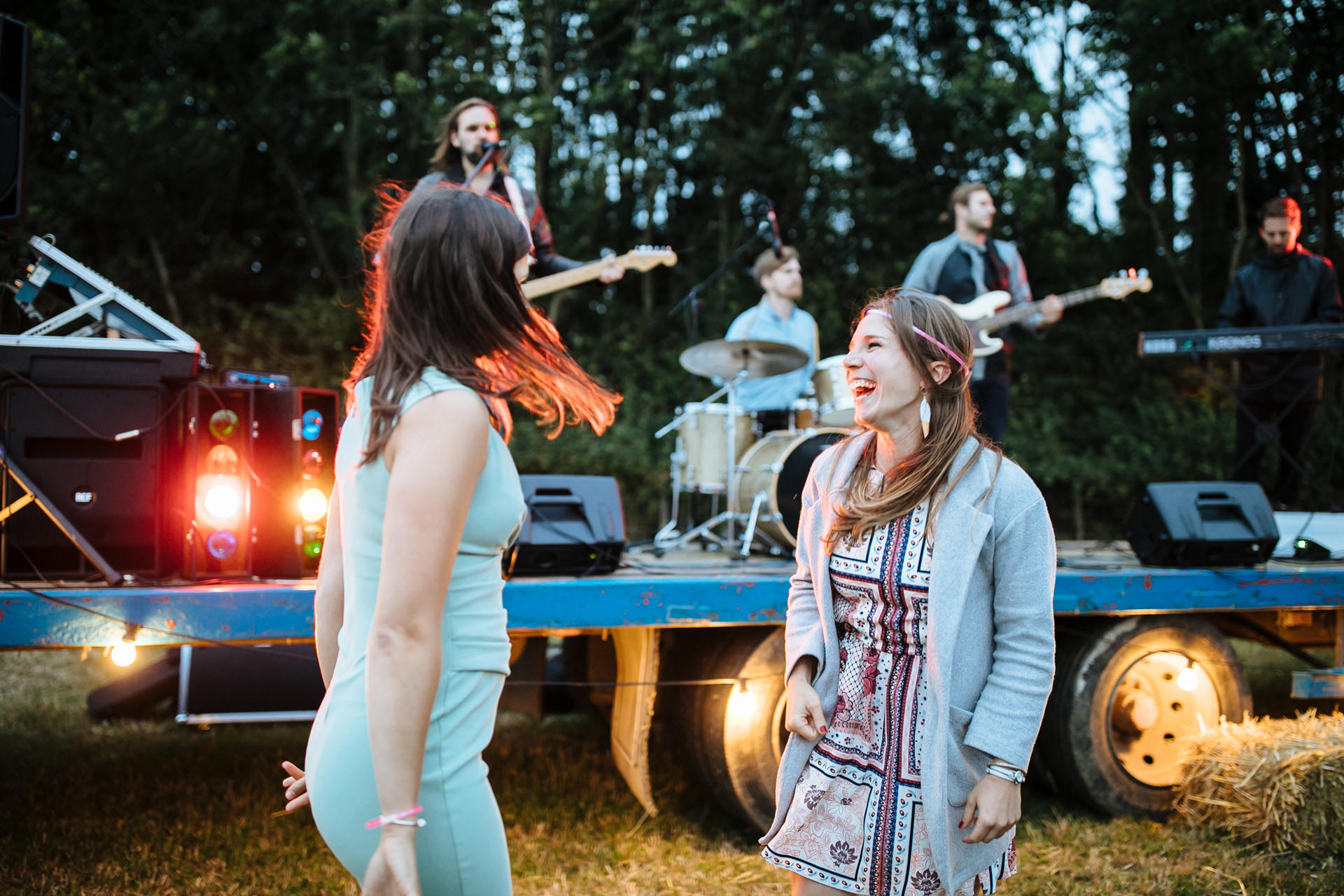 wedding guests dancing at outdoor festival wedding