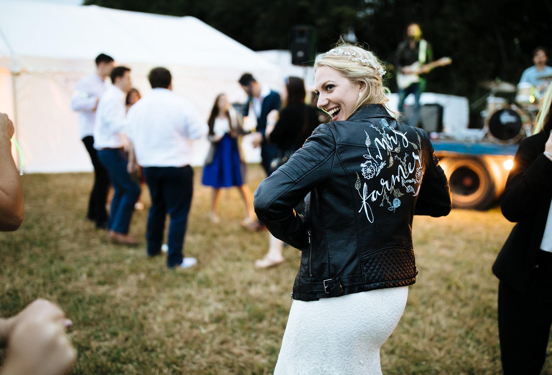bride showing off her leather jacket