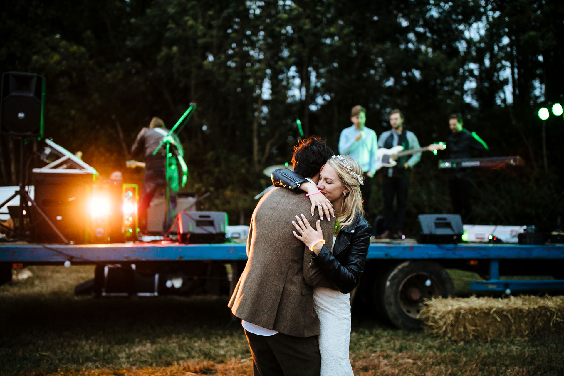 bride and groom first dance outside at festival wedding in Kent