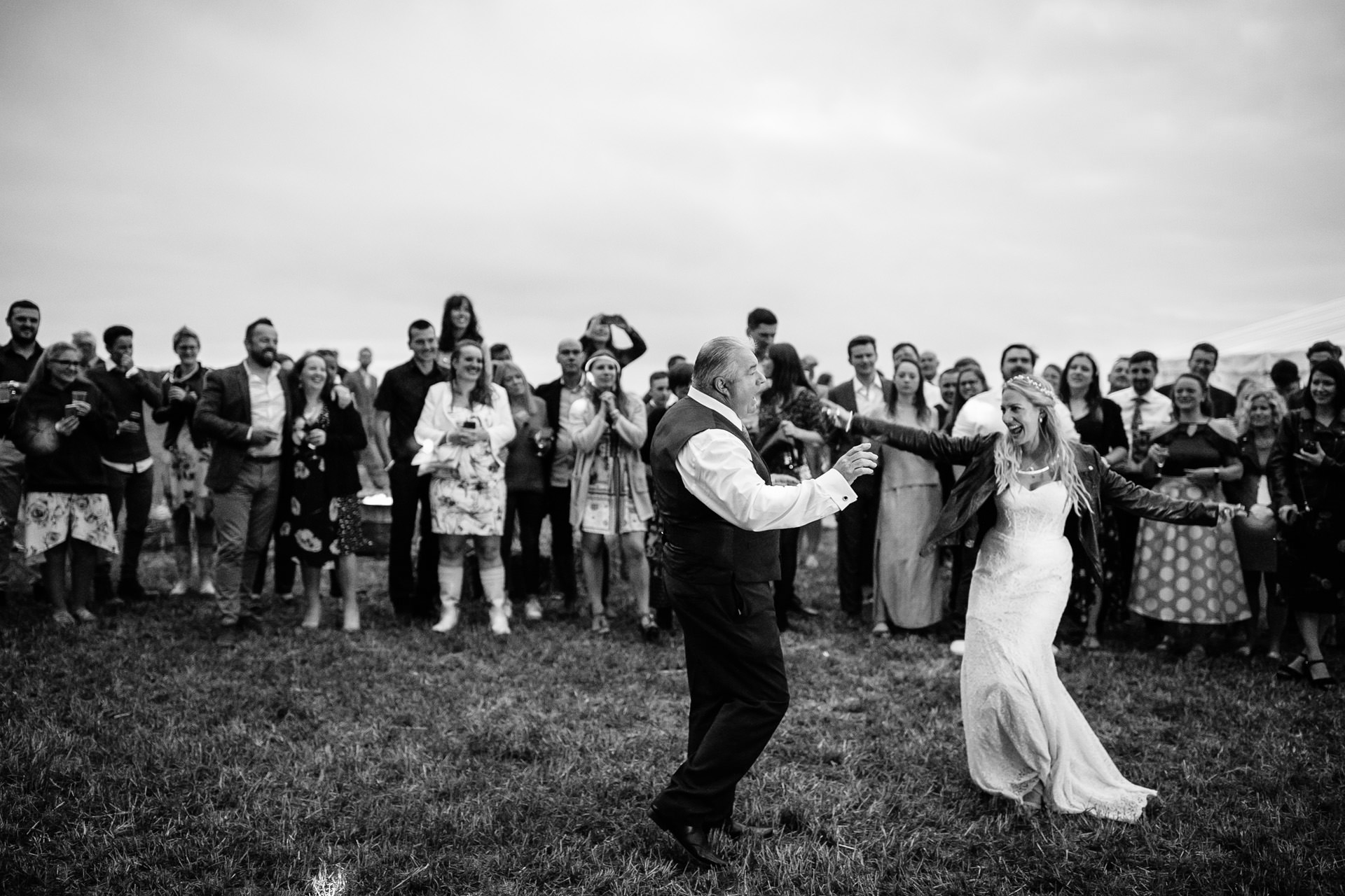 bride and dad dance at outdoor festival wedding in Kent