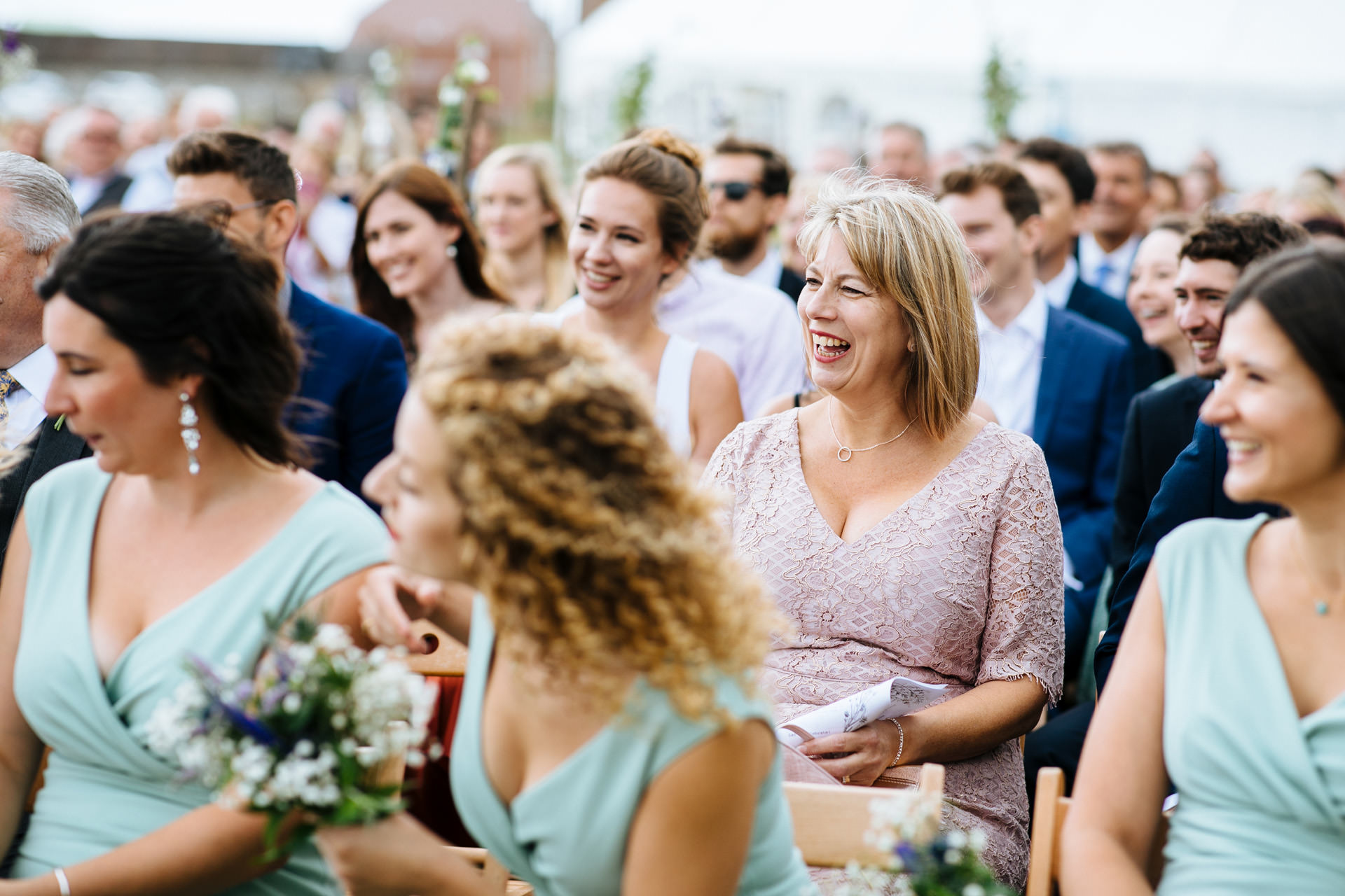 brides mother smiling during wedding ceremony in Kent