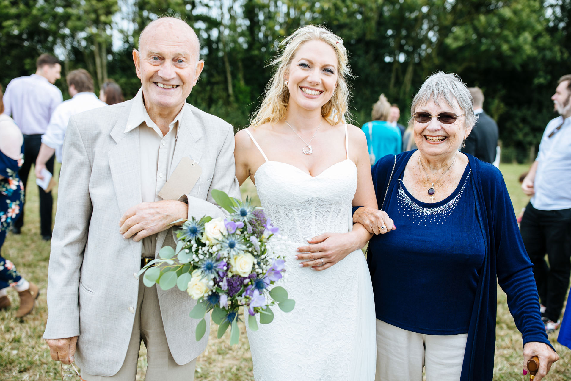 bride posing with her grandparents