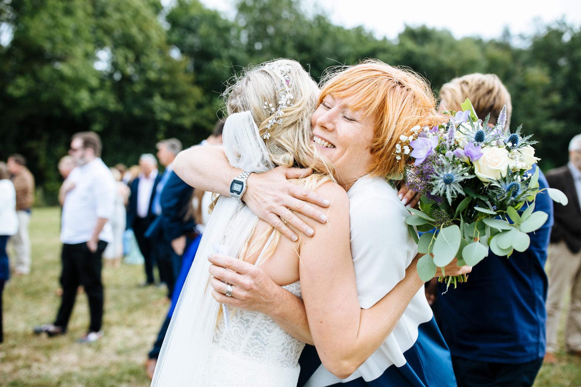 bride hugging her friend at wedding in Kent