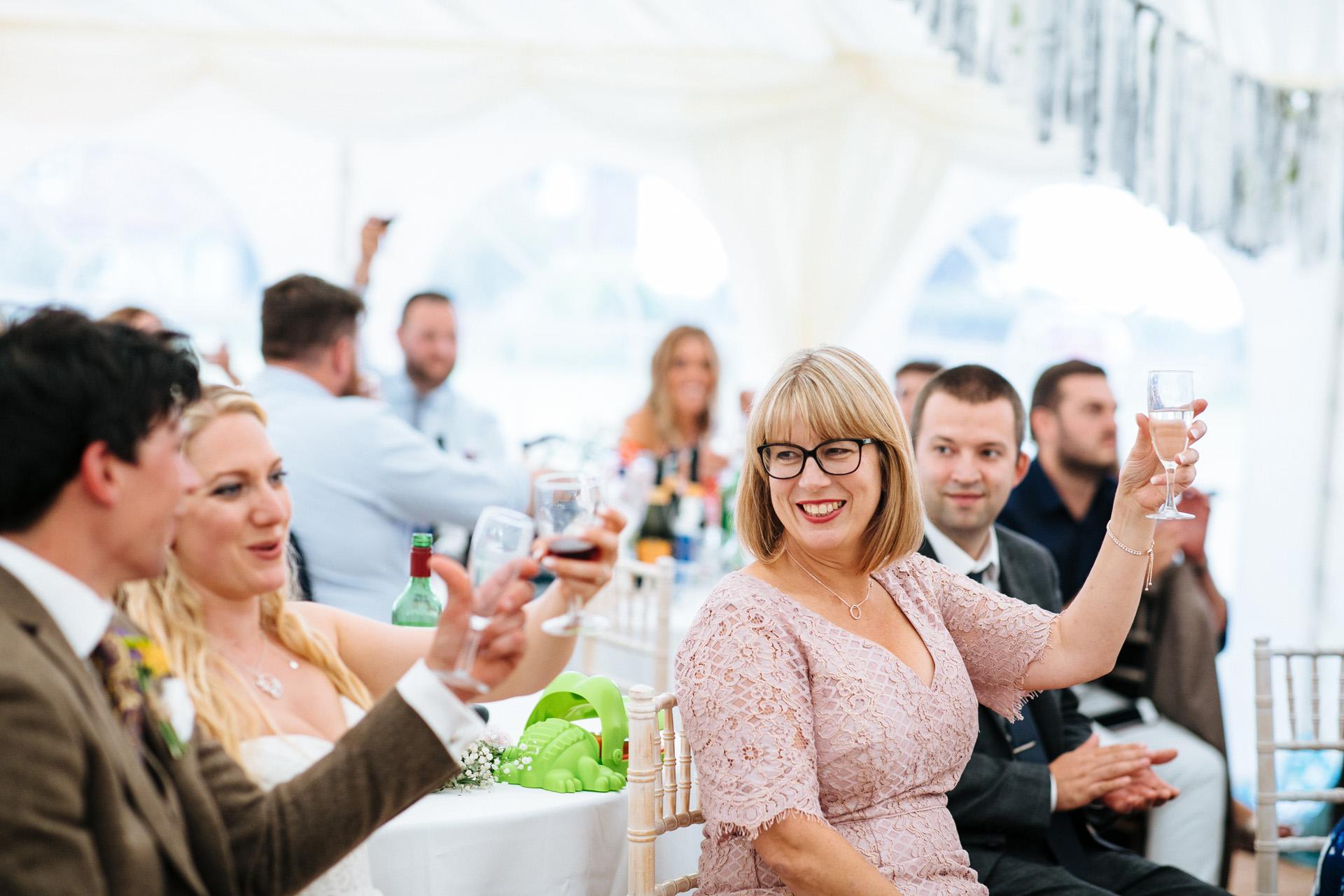 brides mum toasting her glass during speeches