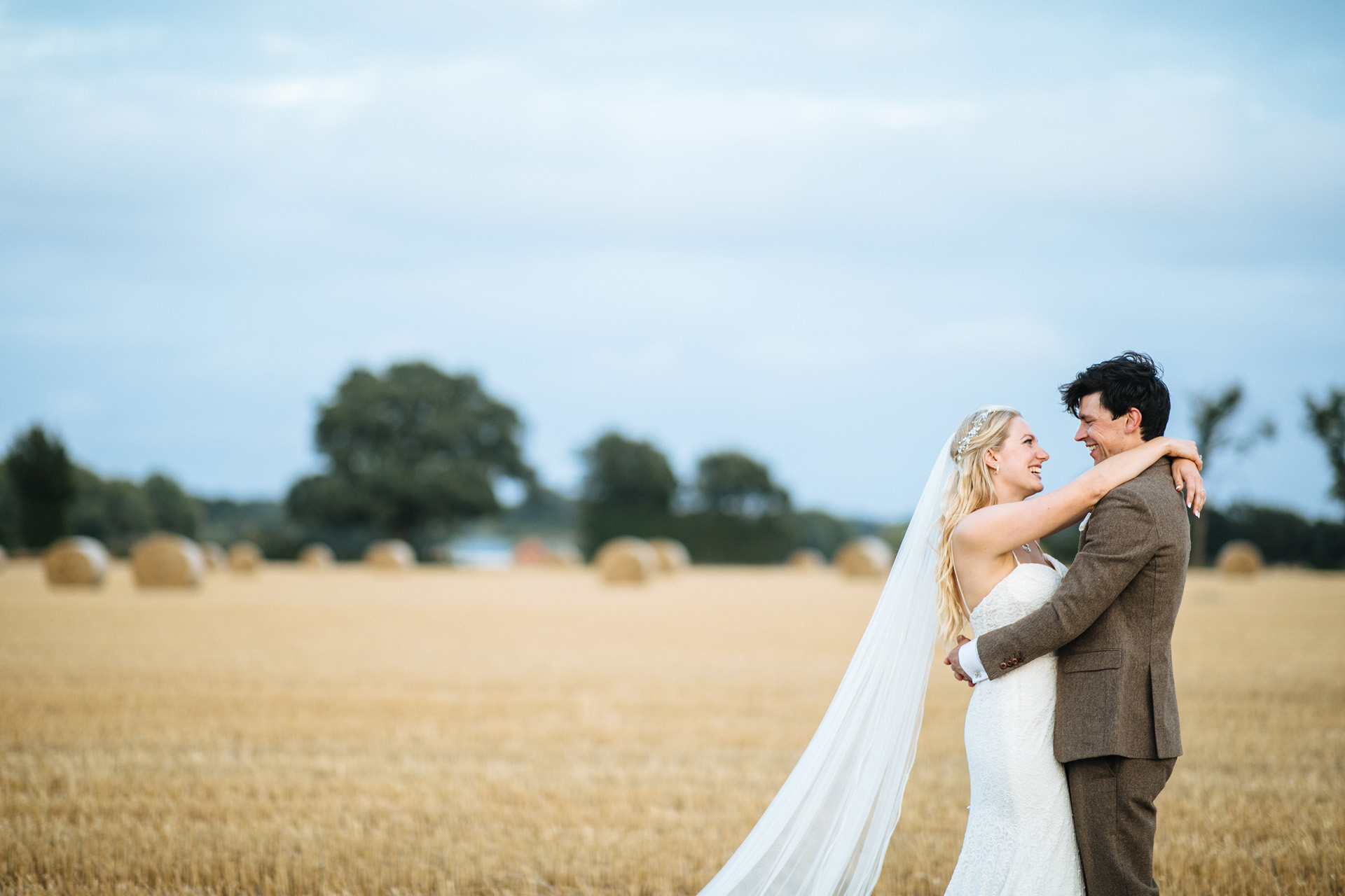 bride and groom in corn field at festival wedding in Kent