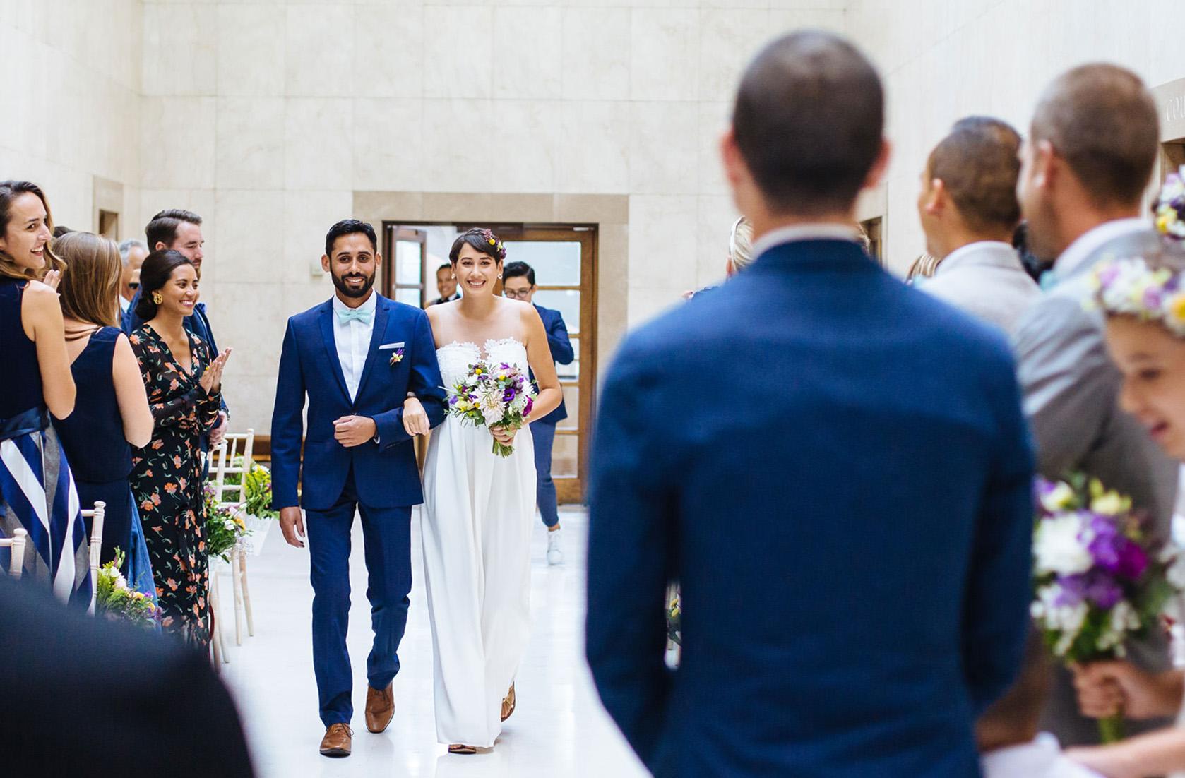 bride walking down aisle at Hammersmith town hall wedding