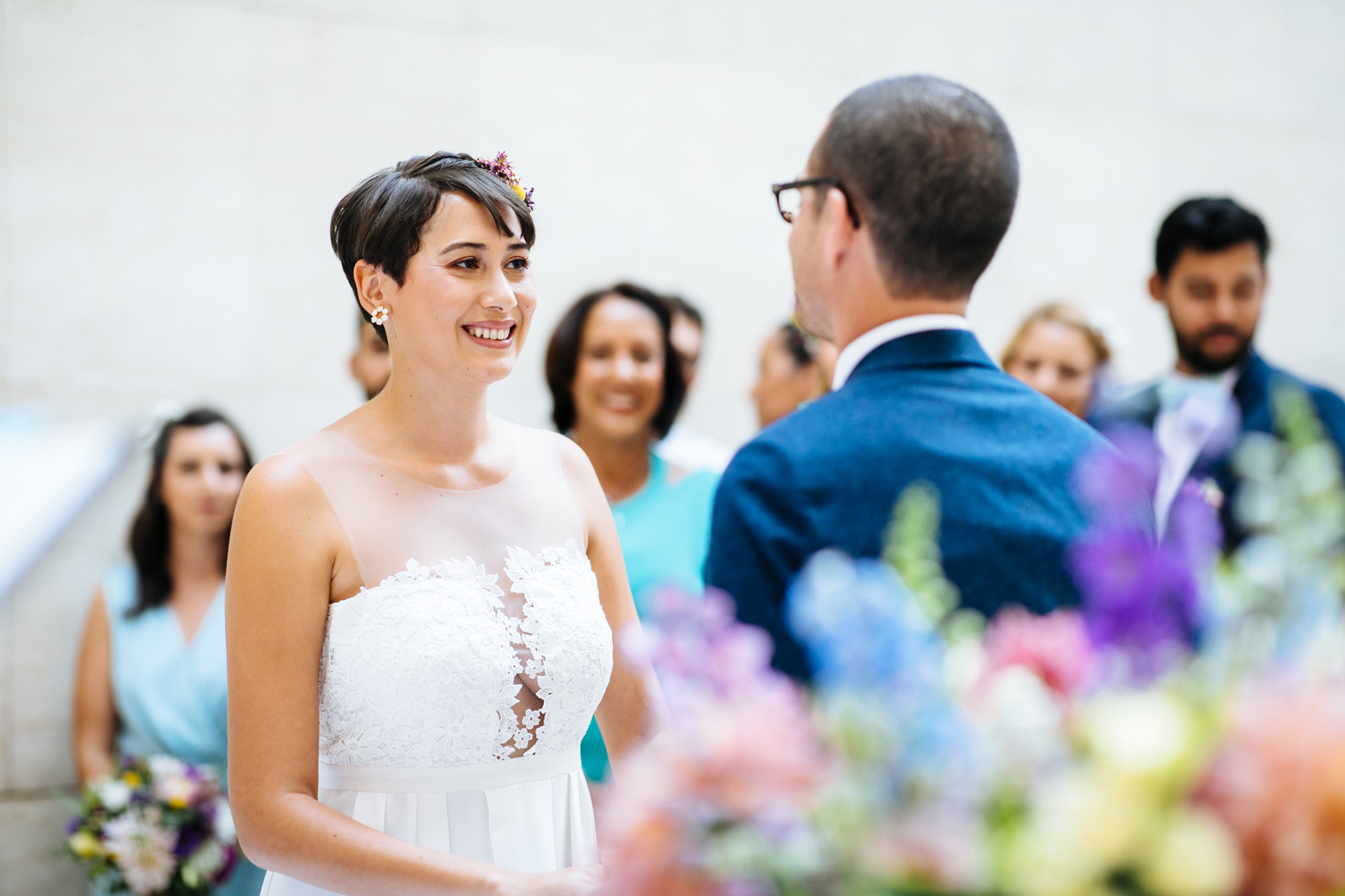 bride and groom smiling during wedding ceremony at Hammersmith town hall