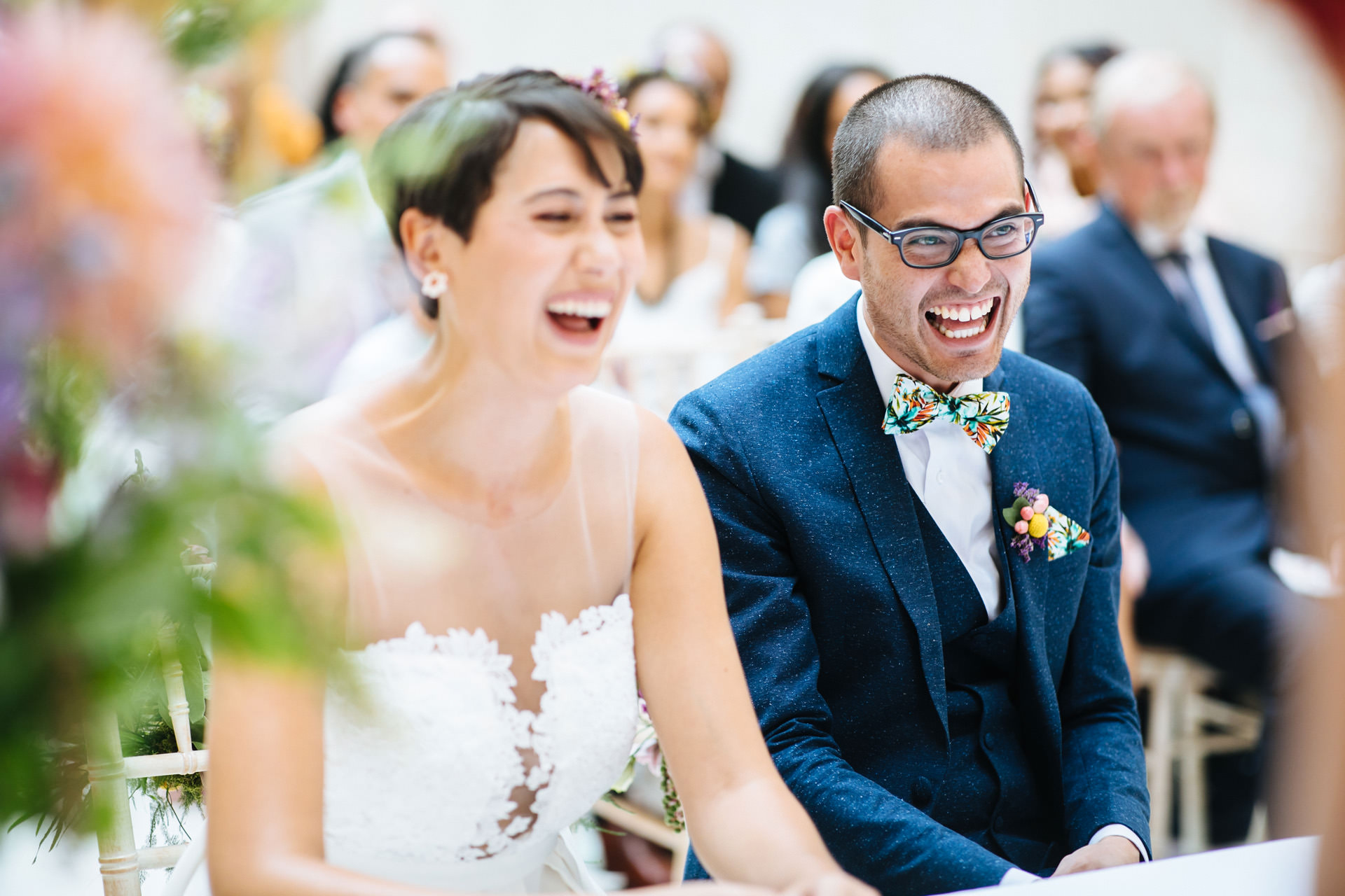 bride and groom laughing during wedding ceremony at Hammersmith town hall