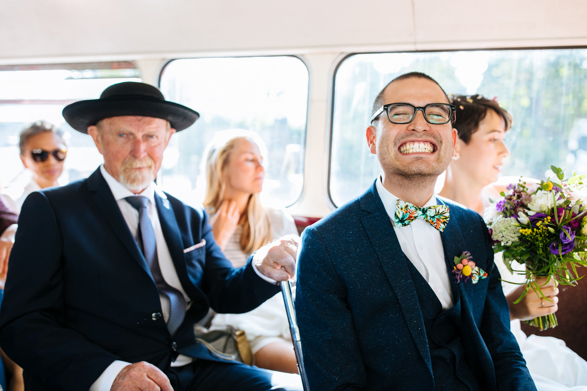 groom smiling on London routemaster