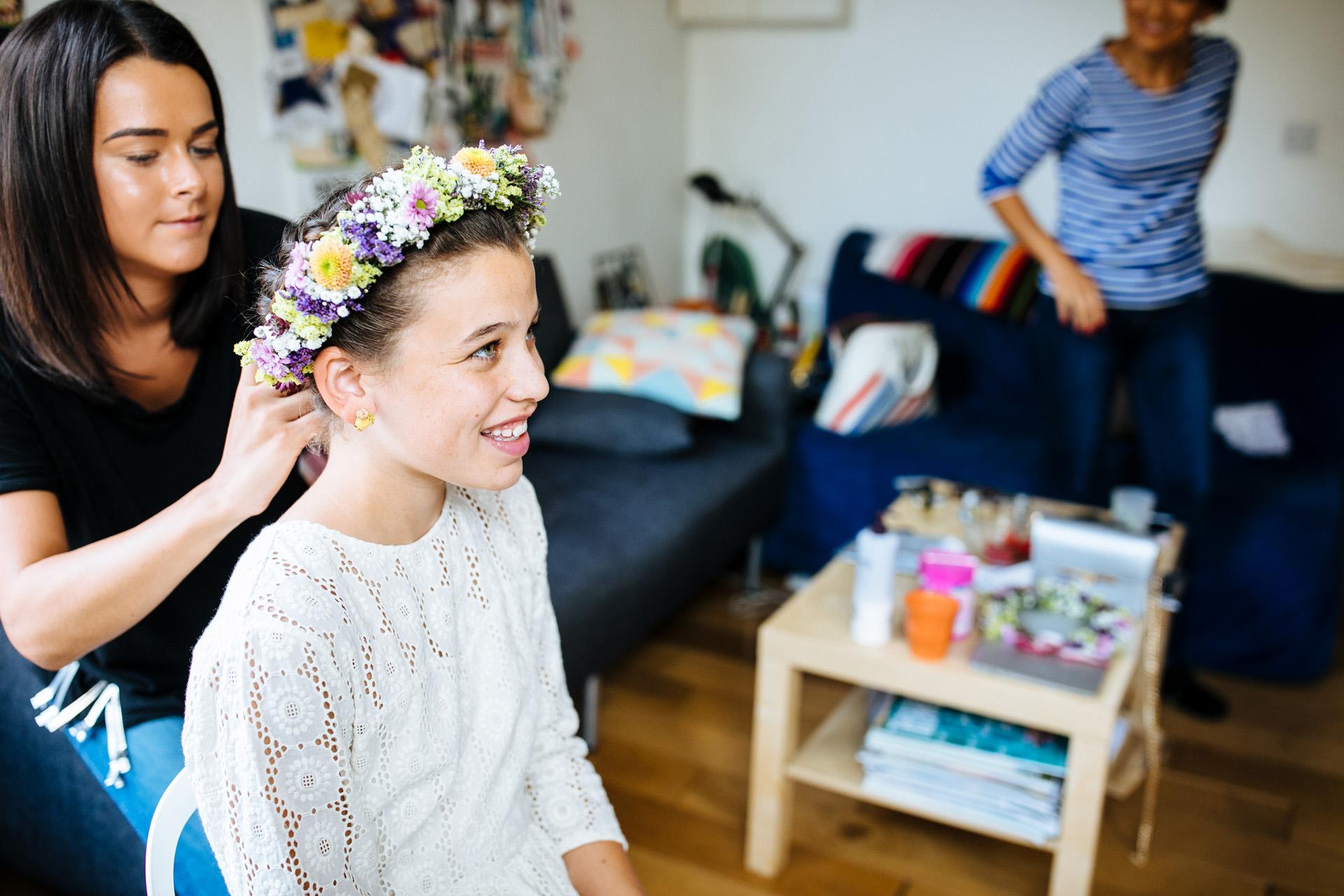 flower girl having flower crown put on